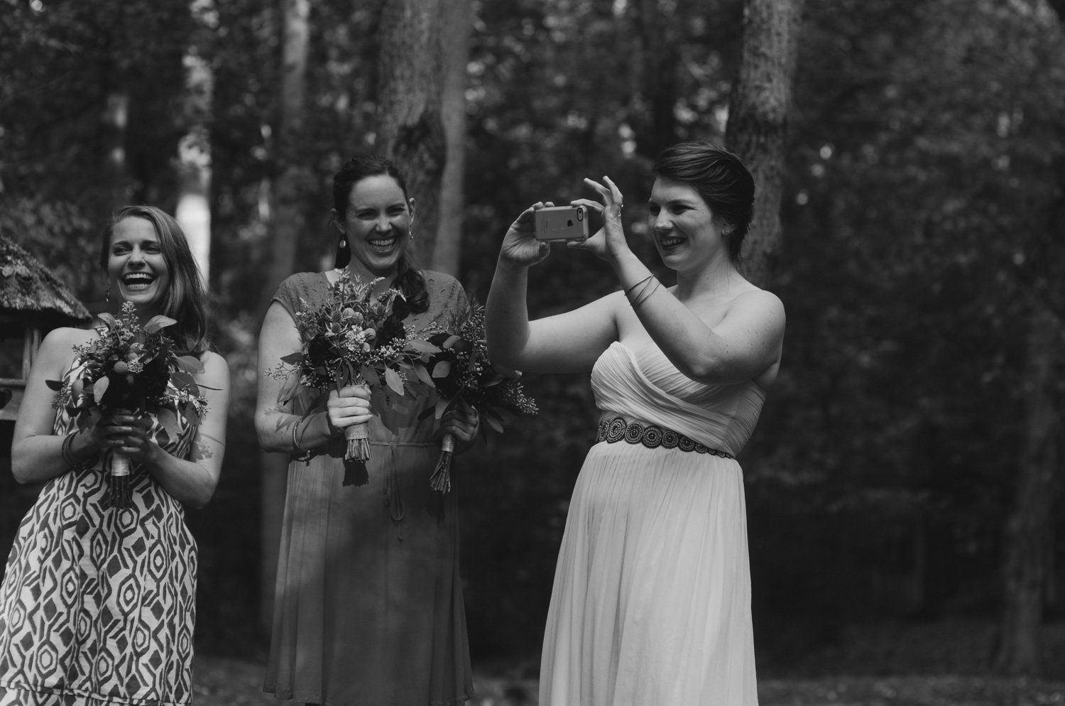 bride taking pictures during ceremony for camp puh'tok wedding