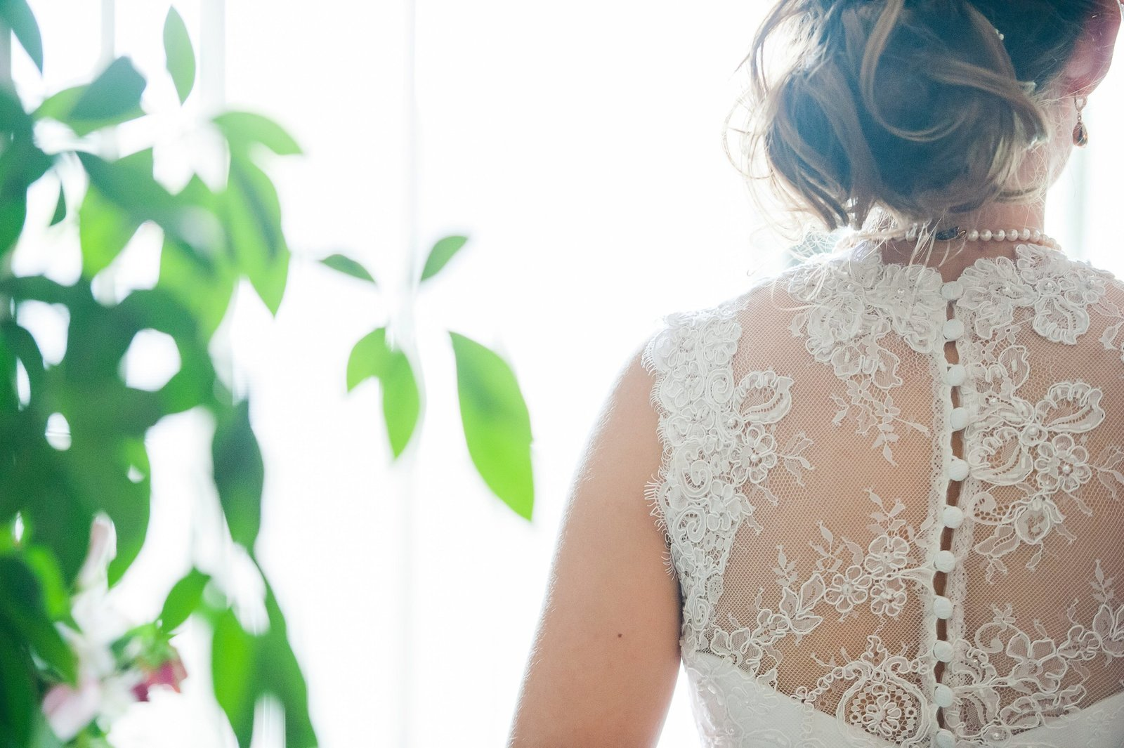 Lacy wedding dress lace and buttons getting ready images by kris kandel