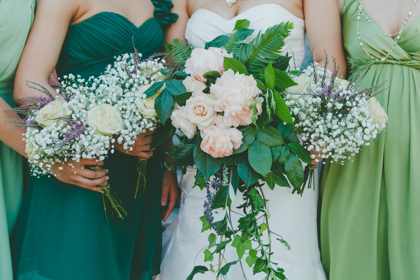 Lush green bride & bridesmaids bouquets