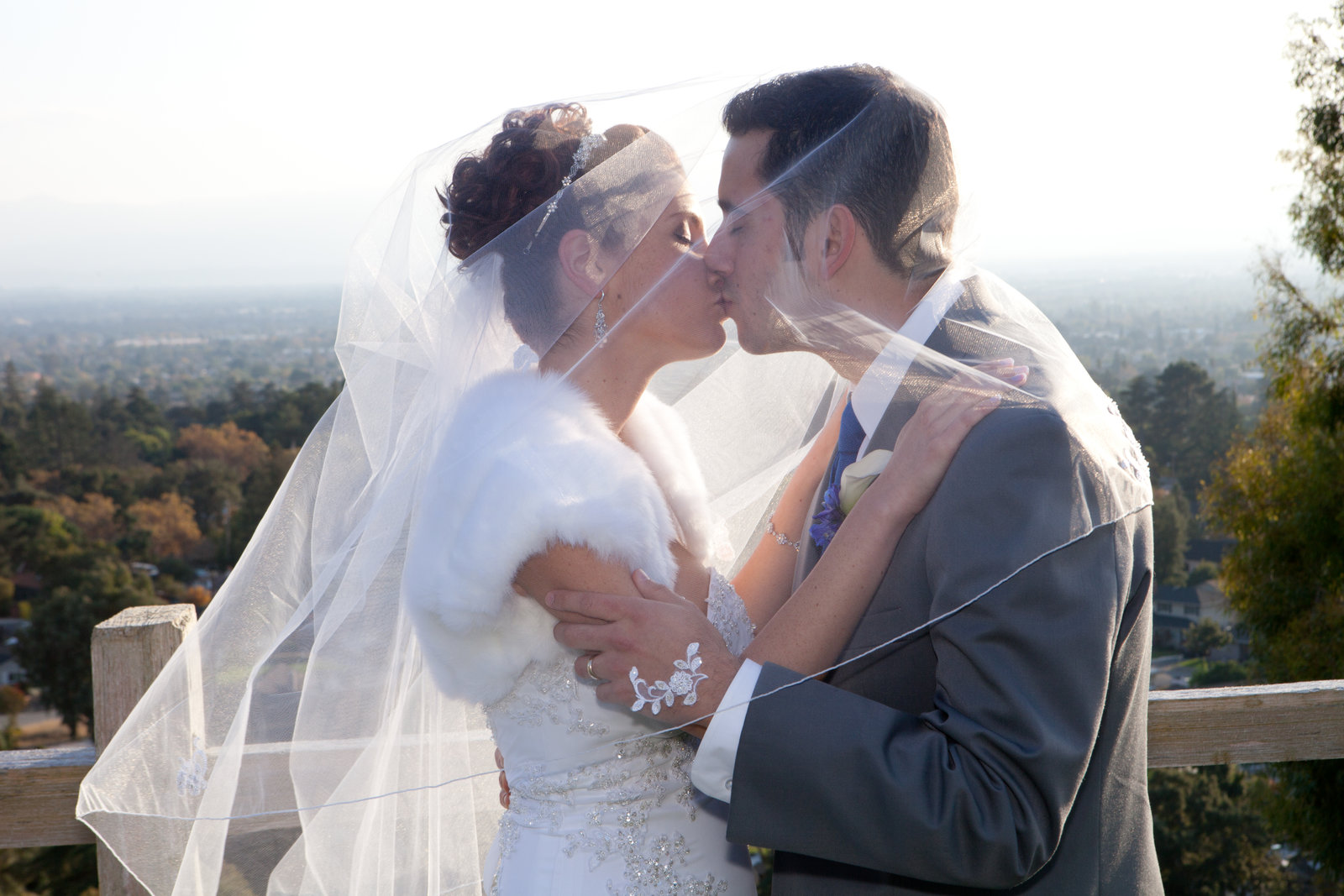 Gorgeous backdrop provides the perfect scenery for bride and groom's kiss