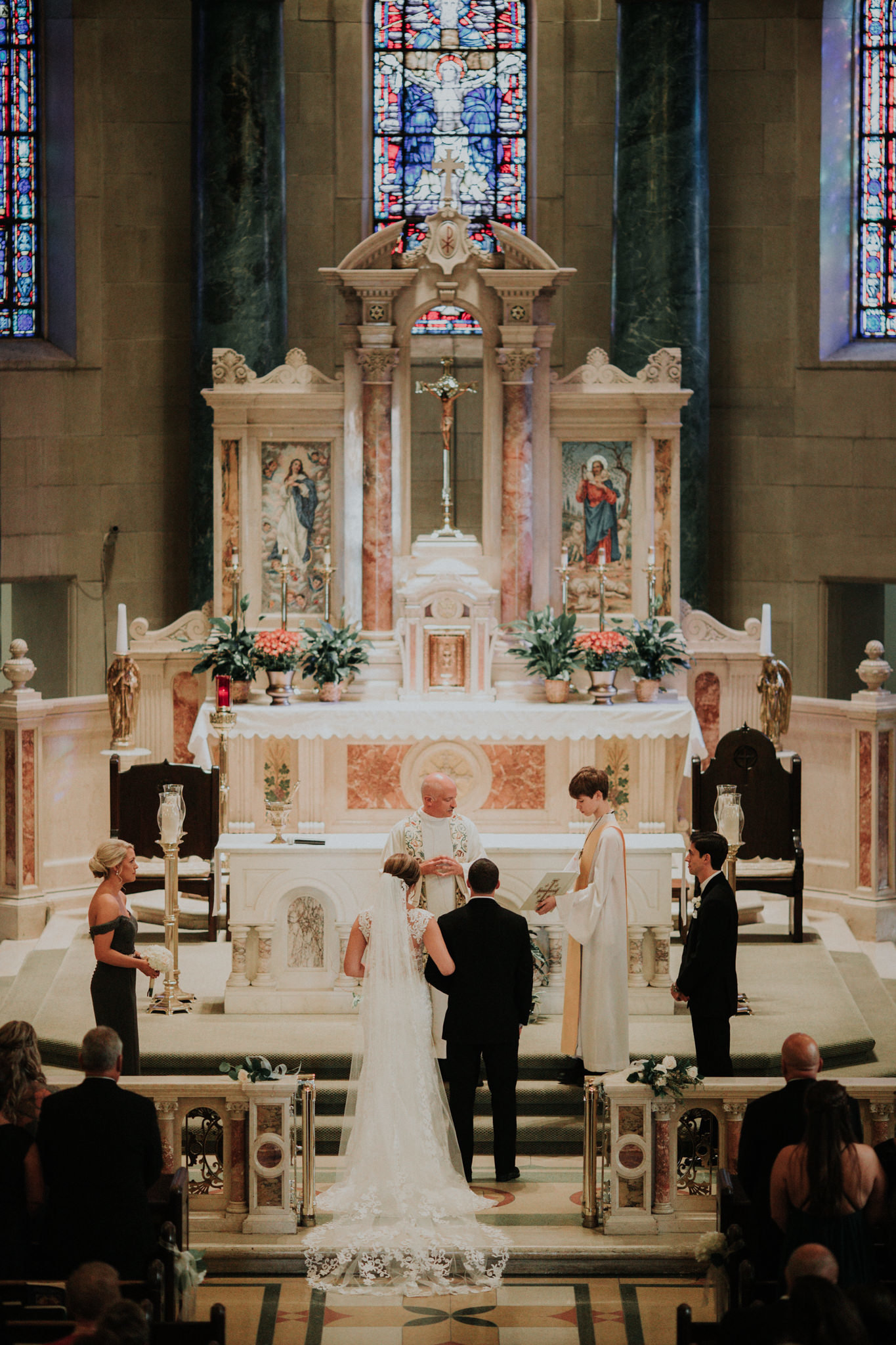 bride and groom marry at st elizabeths church in wilmington delaware