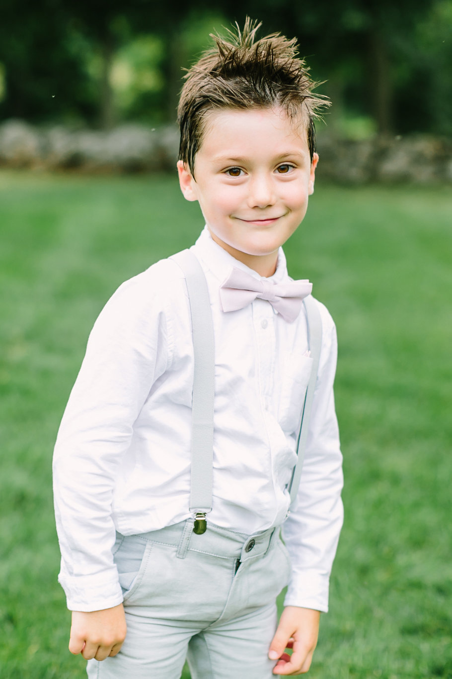 adorable ringbearer with bowtie and suspenders