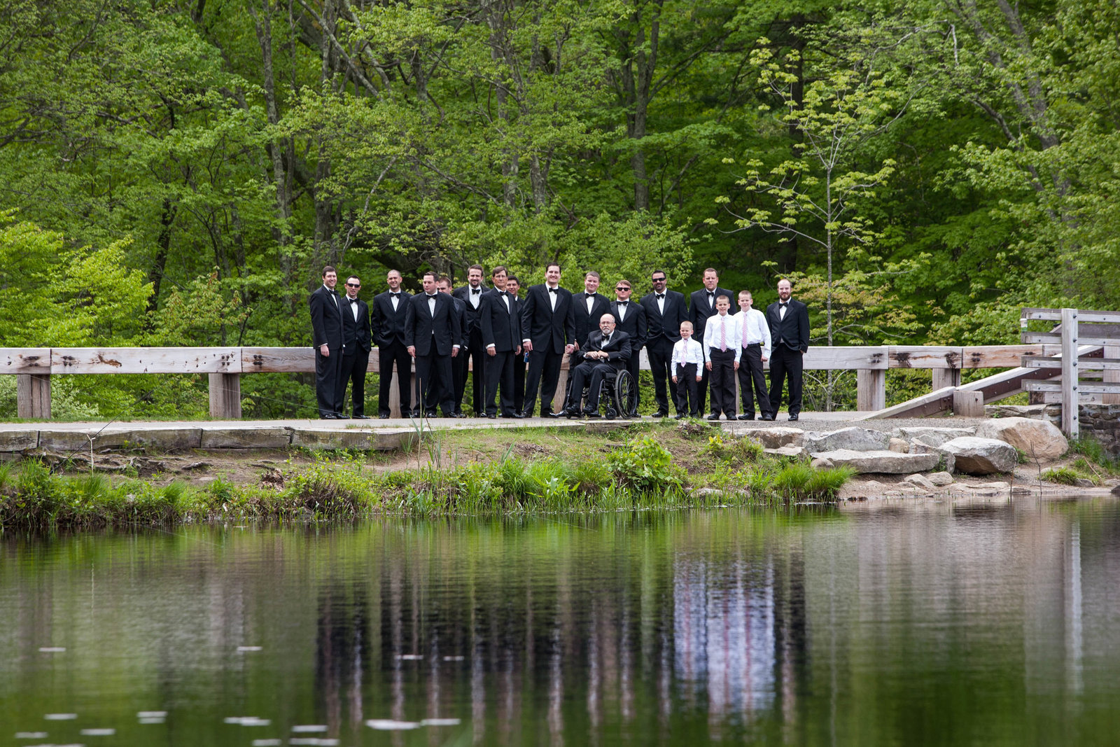 groomsmen at lake edge