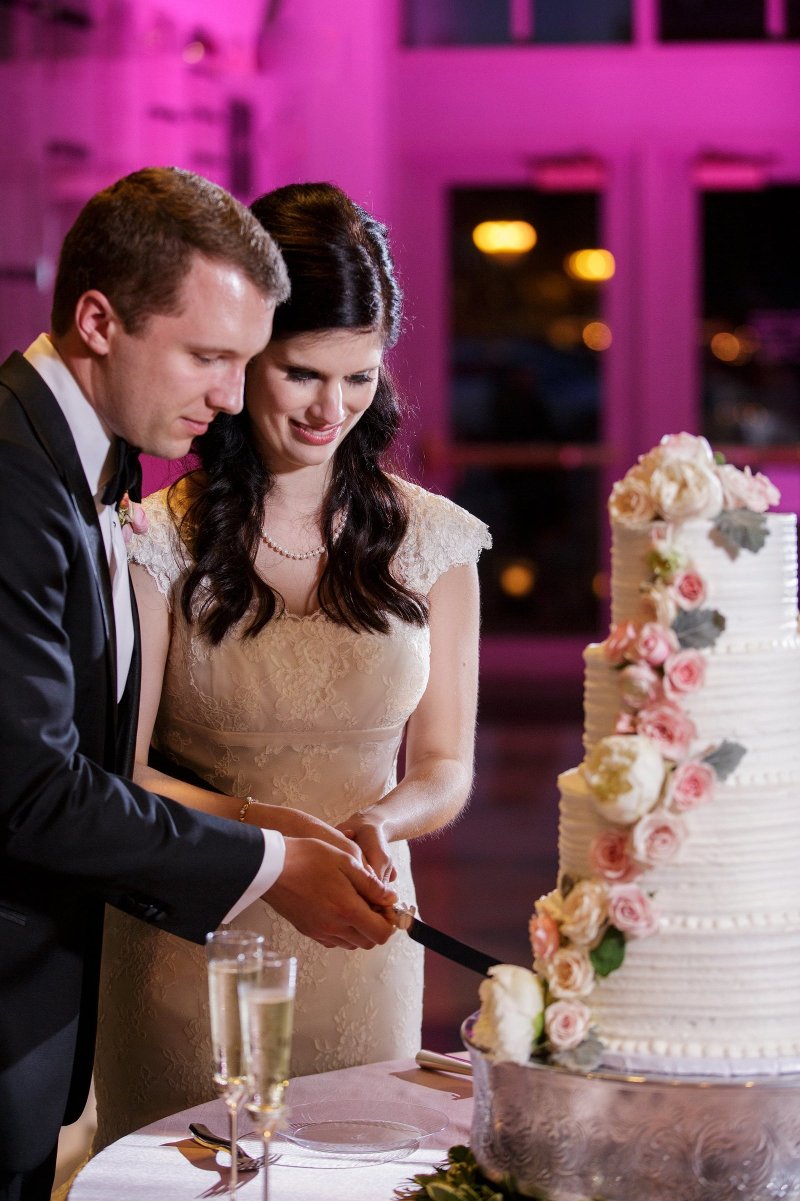 bride-groom-cutting-cake-on-wedding-day