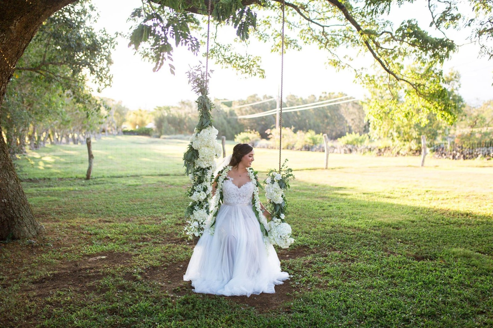 bride on floral swing
