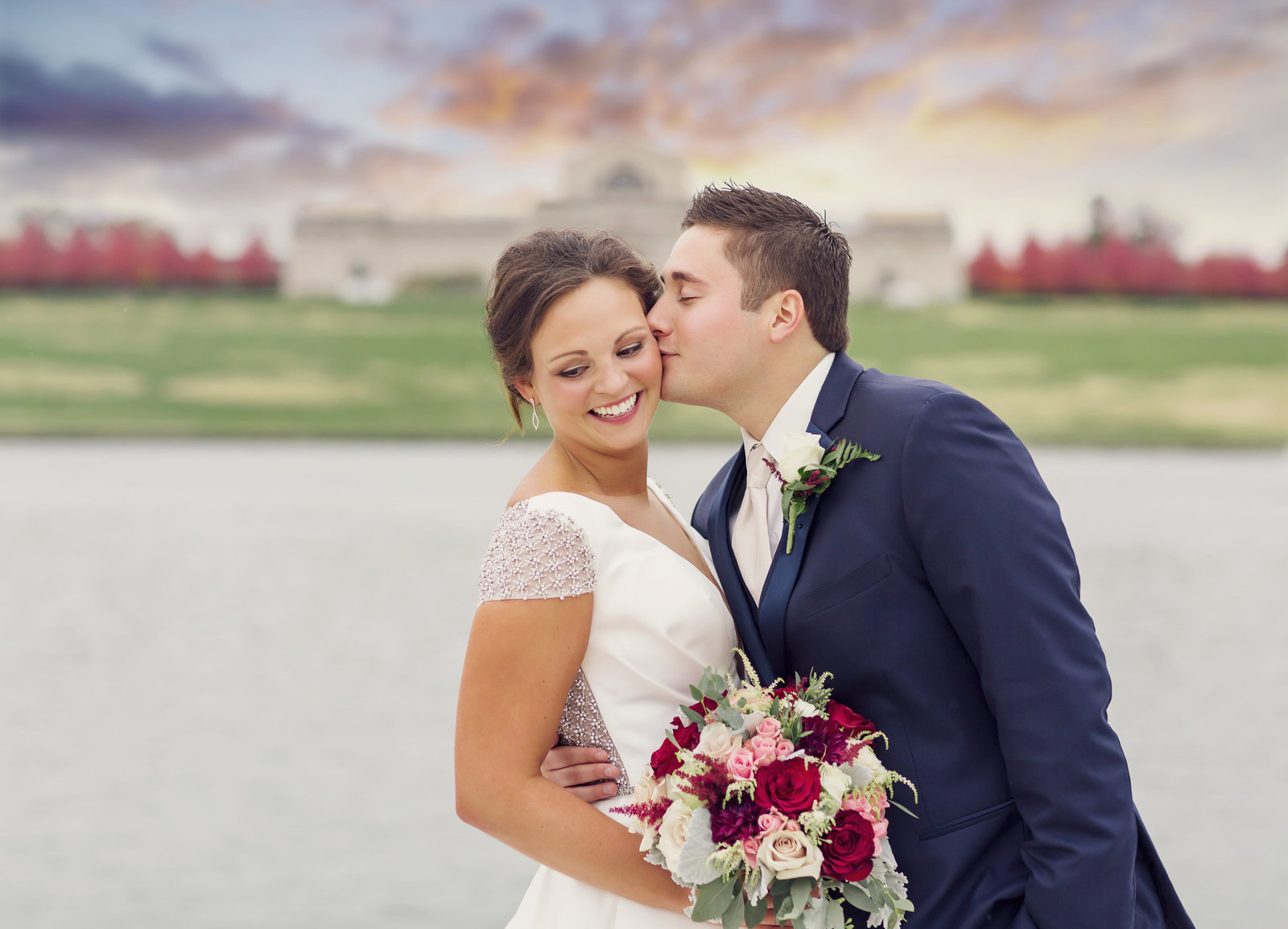 Bride and Groom, Suzie and Ale, pose at sunset in from the St. Louis Art Museum Grand Basin by Jackelynn Noel Photography