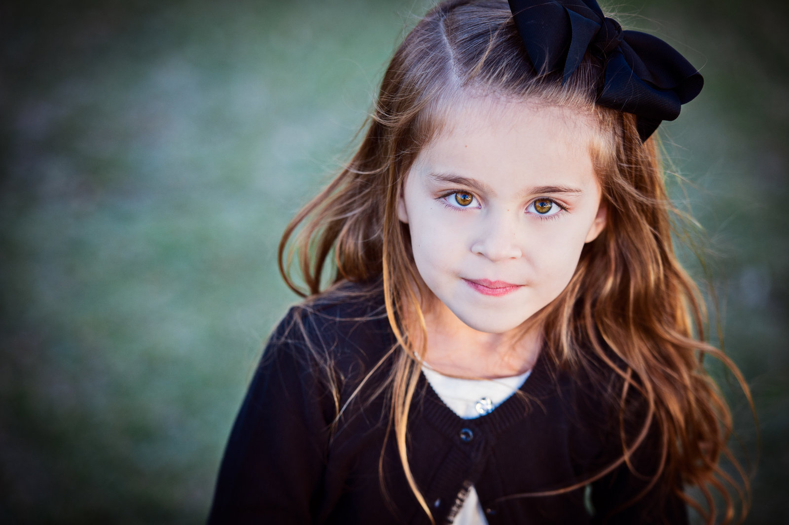 little girl with big black bow in hair