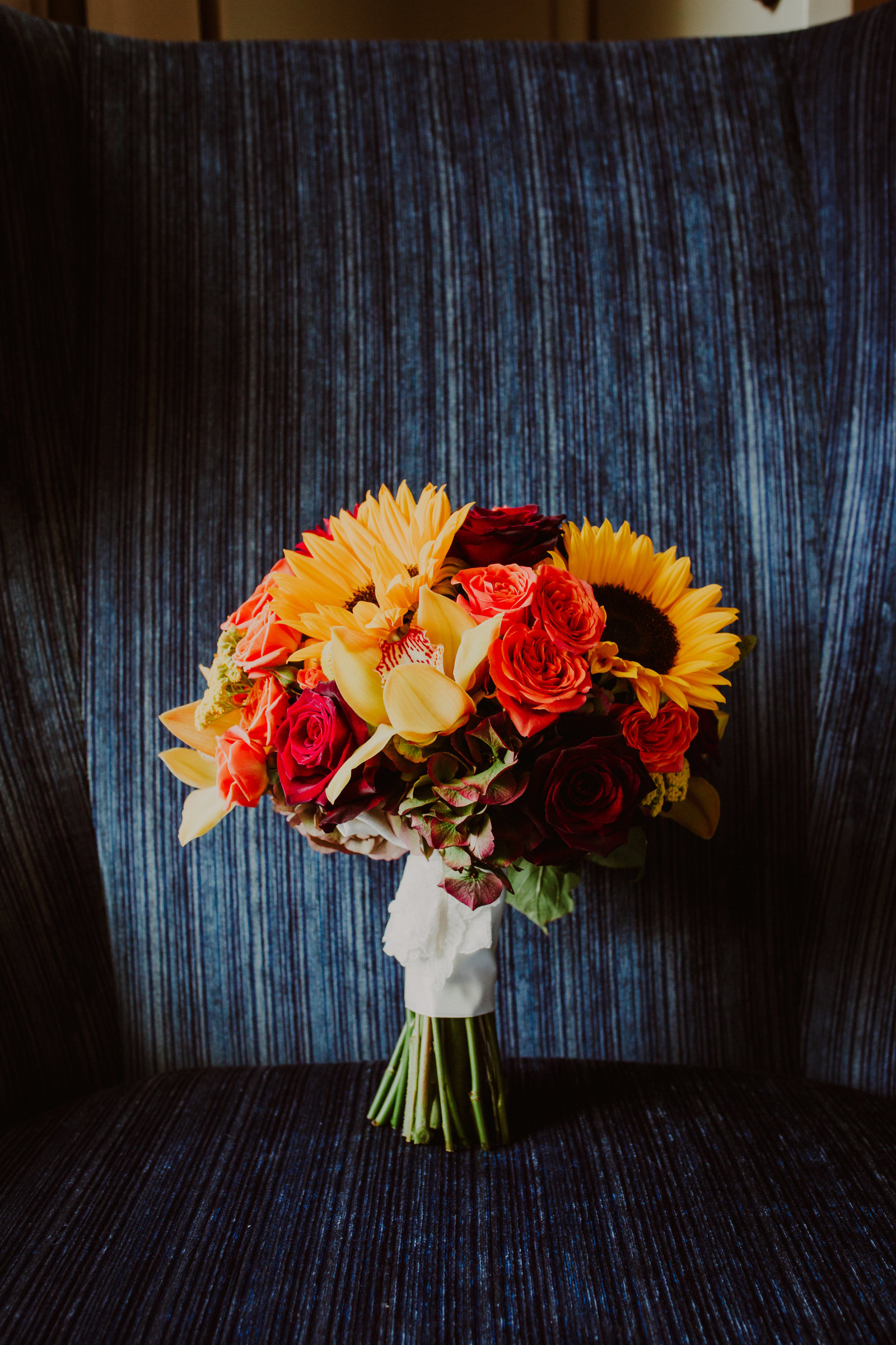 fall wedding flowers in yellow and red with sunflowers