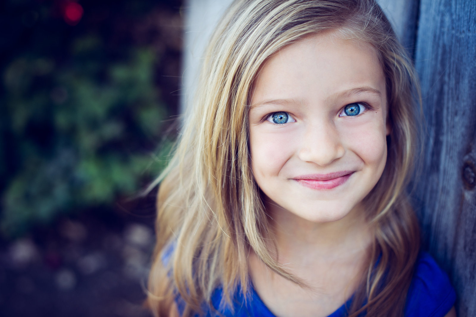 headshot of child with stunning blue eyes