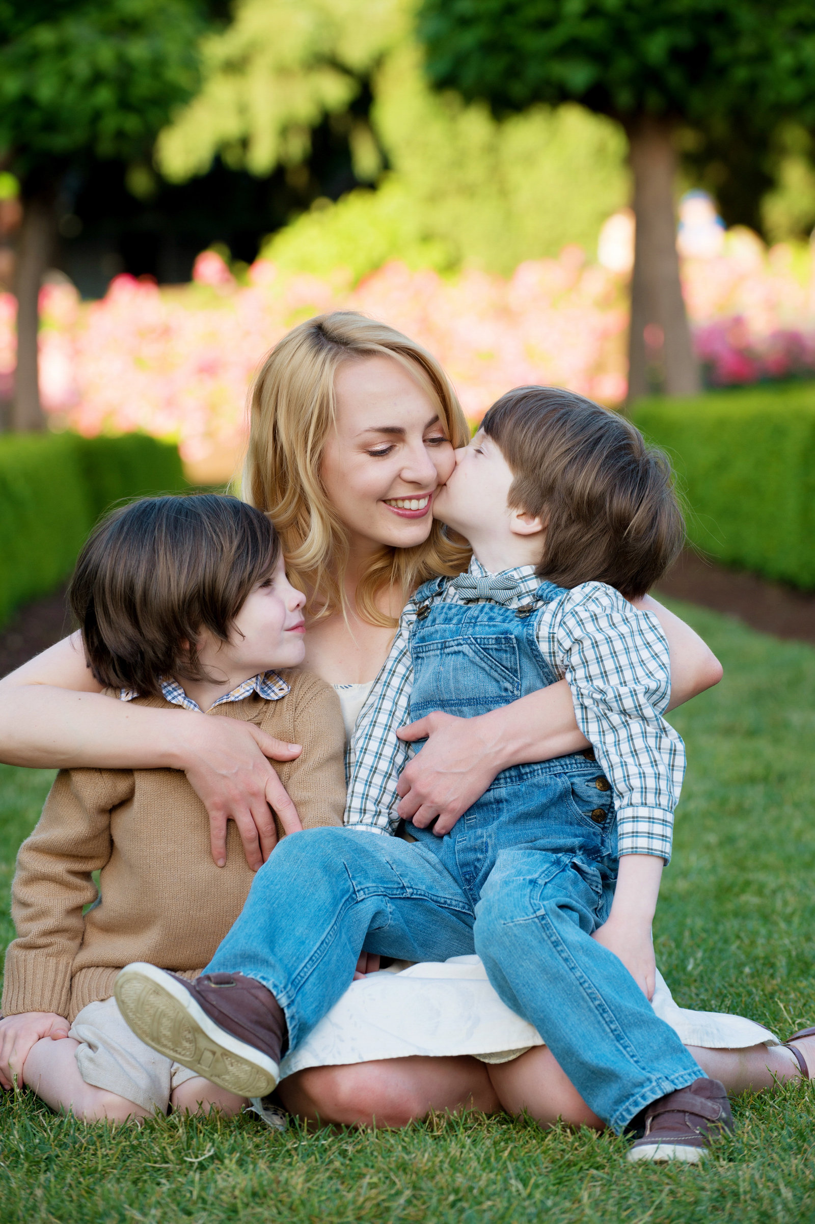 a mom hugs her two sons close at peninsula park rose garden