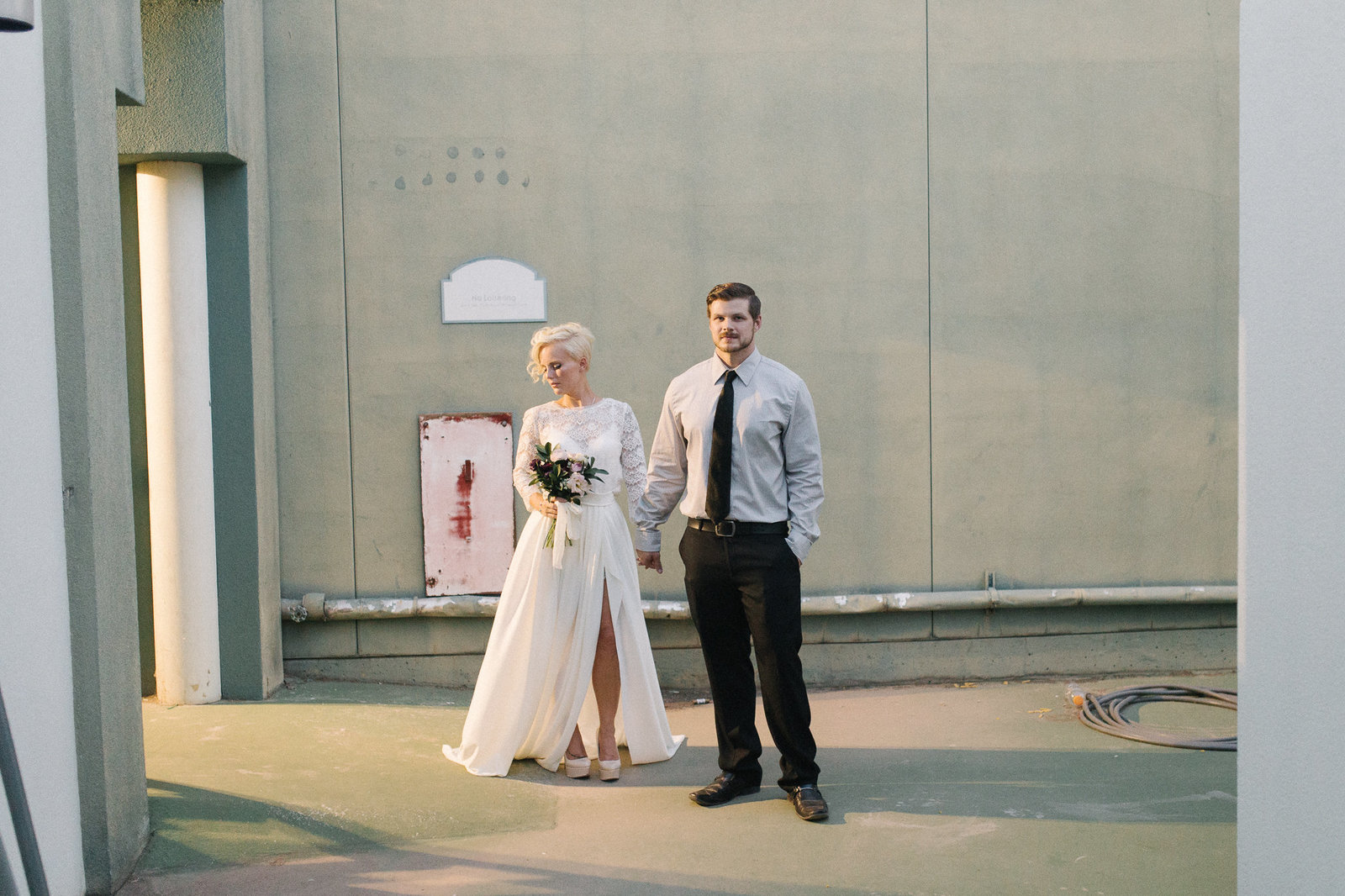 Bride and Groom embrace after ceremony during golden hour in modern elopement in Phoenix, Arizona