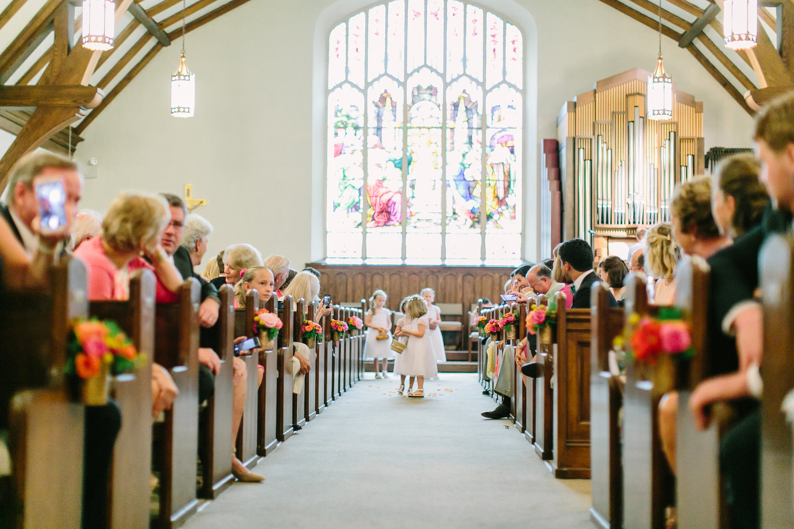cutest flower girls walking in church