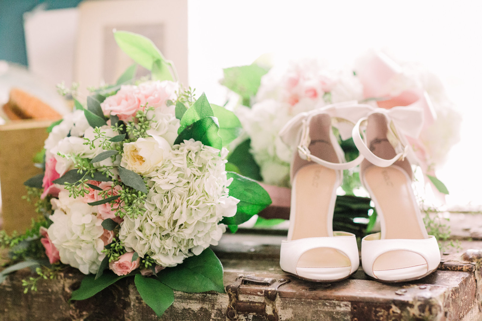 These details of Liz's wedding shoes and flowers pop in natural sunlight in the bridal cabin at Dodson Orchards