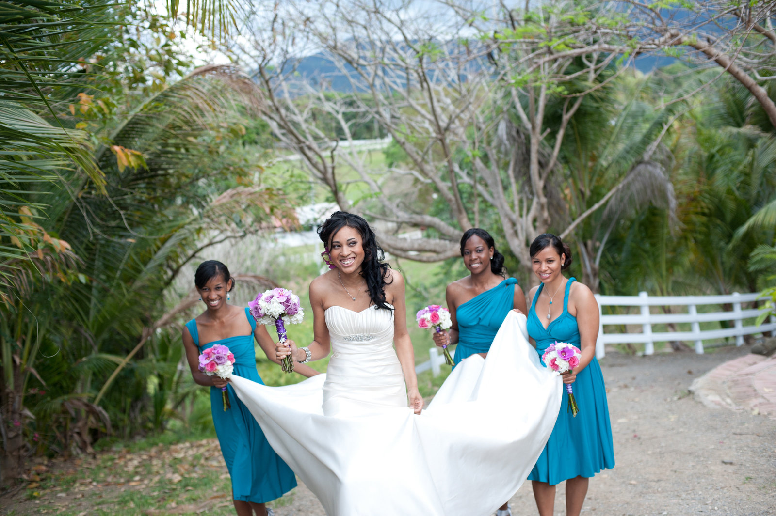 bridesmaids carry bride's train in puerto rico