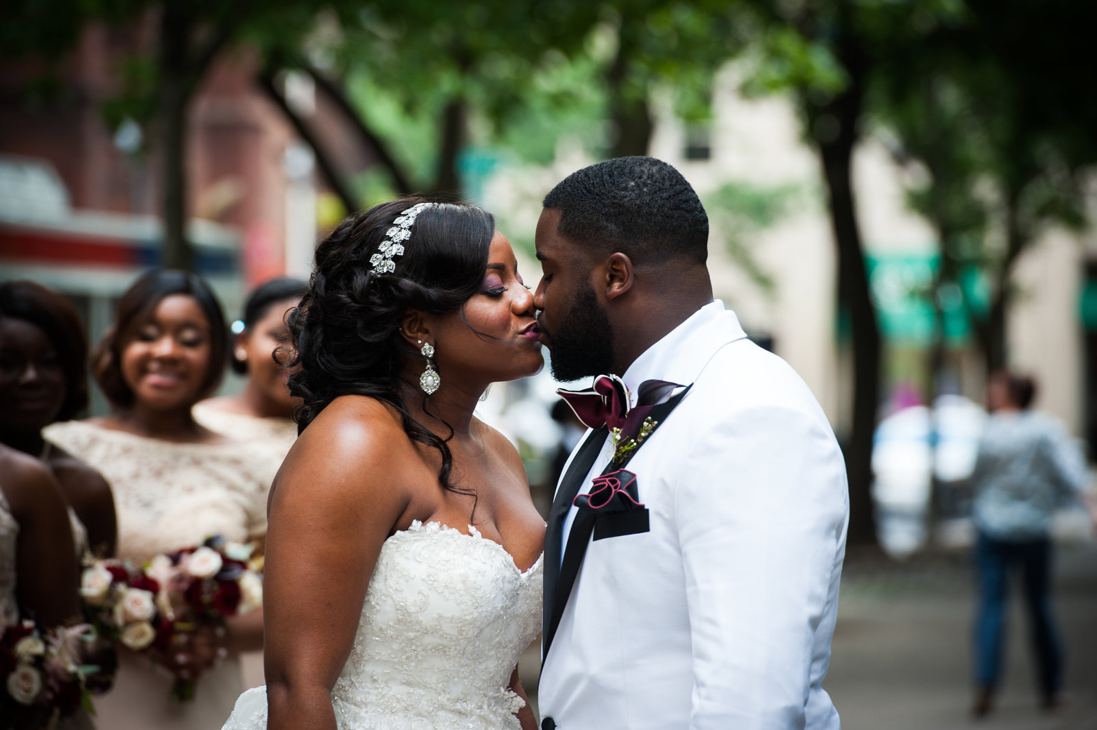 Bridal portraits in rittenhouse square philadelphia,  photos  by Greg Davenport Photography bride gown from Kleinfeld Bridal groom in custom tux