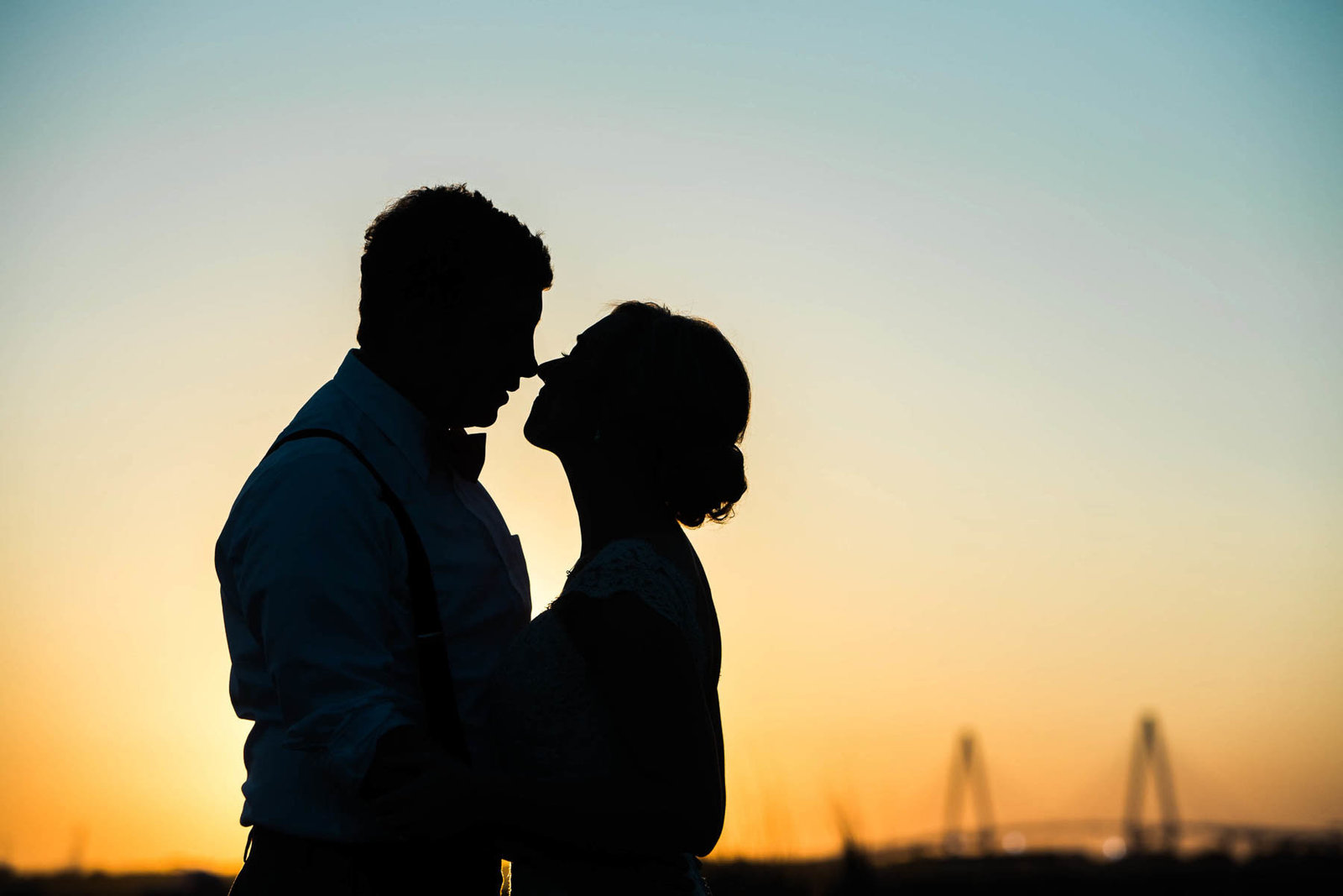 Bride and groom stand near Ravenel Bridge at sunset, Alhambra Hall, Mt Pleasant, South Carolina