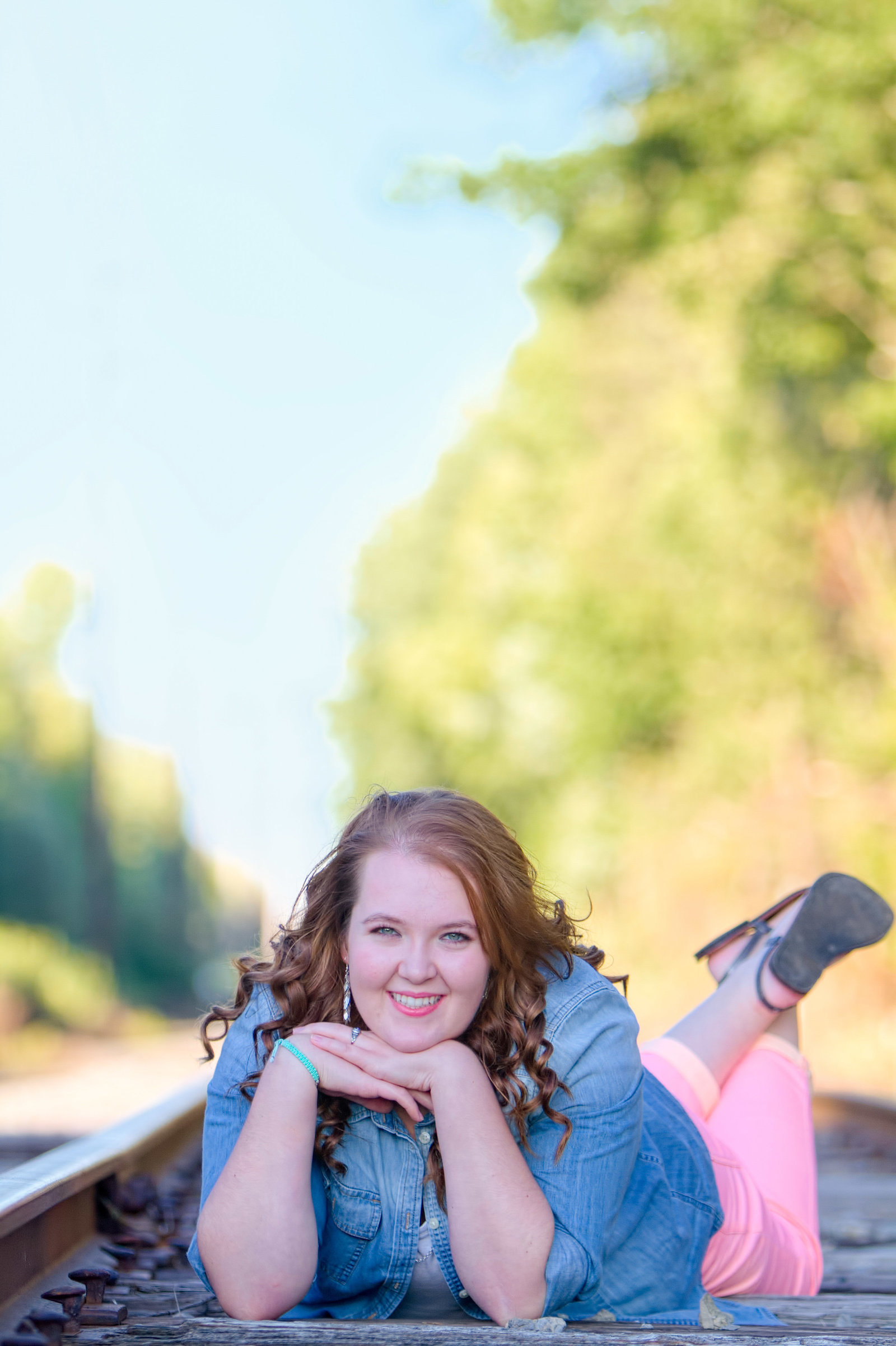 Senior portrait on railroad track