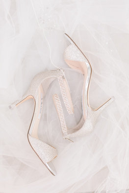Bride's high-heel shoes with jewels laying back to back