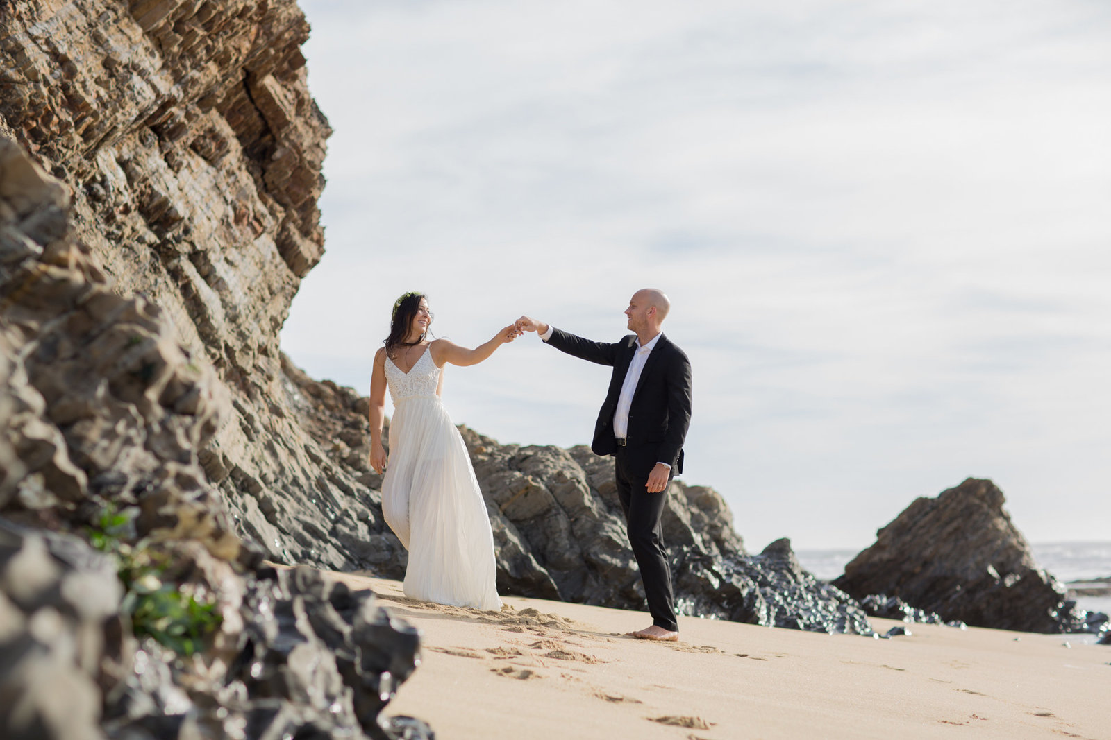 Striking bride and groom enjoying seaside wedding at Ritz Carlton beach in Half Moon Bay California