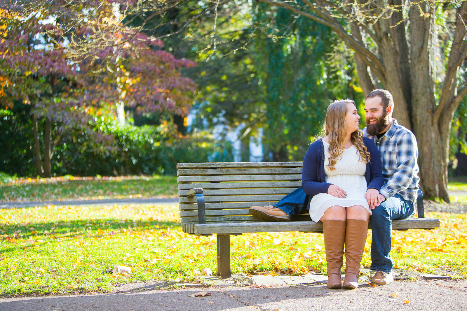 engagement portrait on bench in higland park