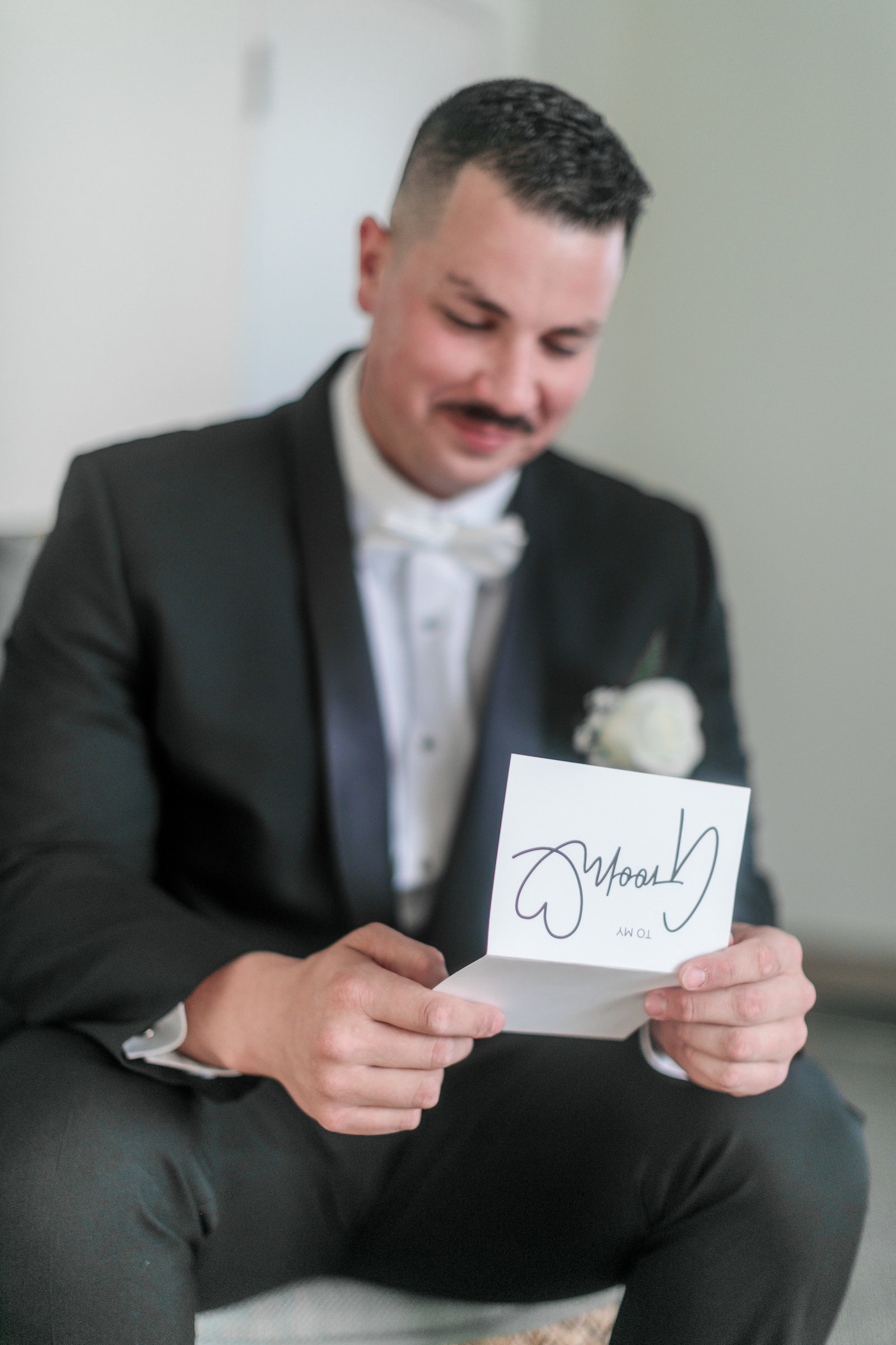 Groom reading his letter from bride
