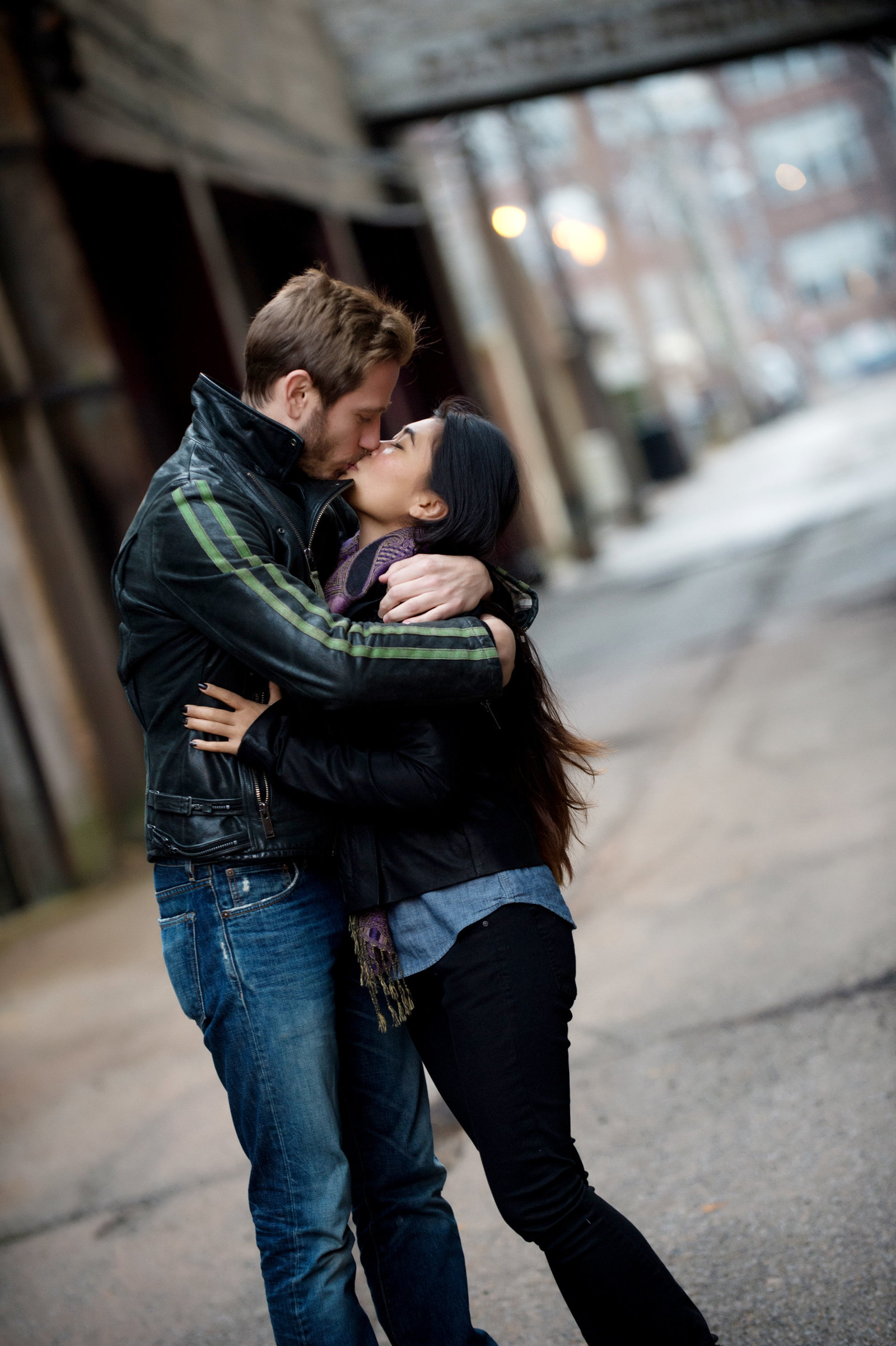 an engaged couple kiss in chicago
