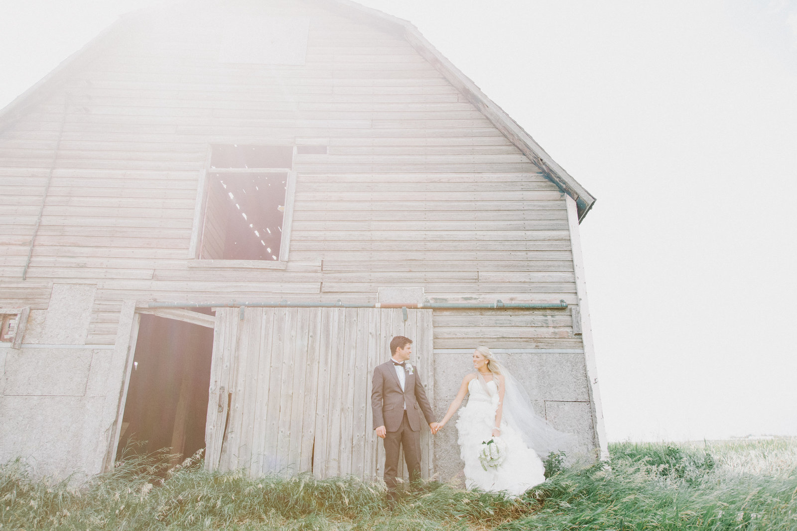 Bride and Groom by barn rustic glam wedding, Regina, SK Wedding Photographer