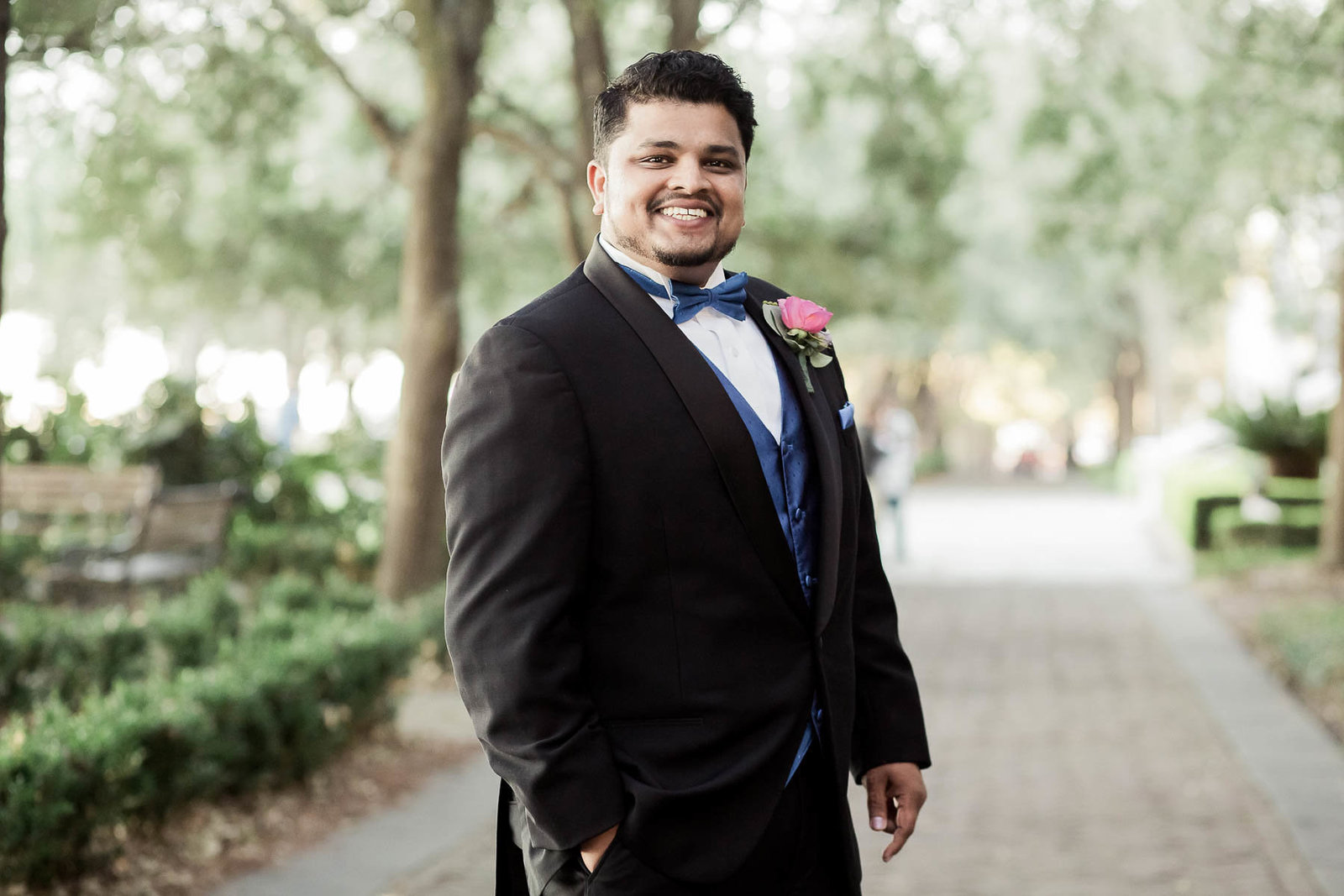 Groom stands under trees at Waterfront Park, South Carolina