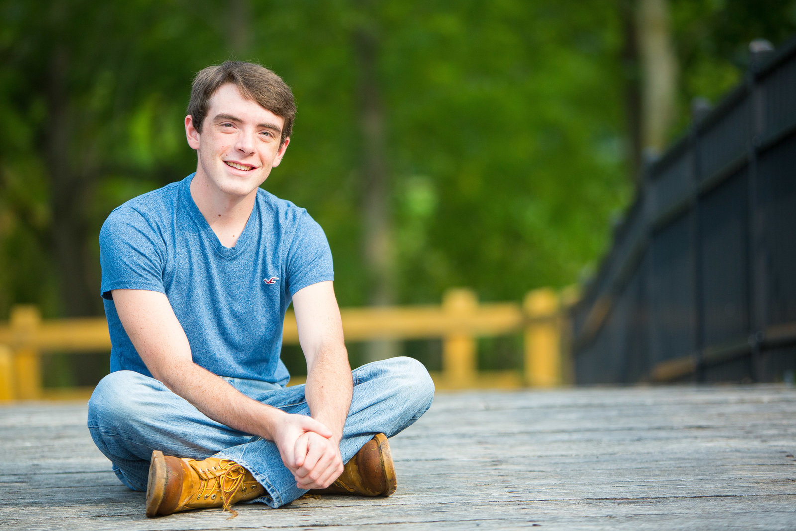 male senior portrait on bridge