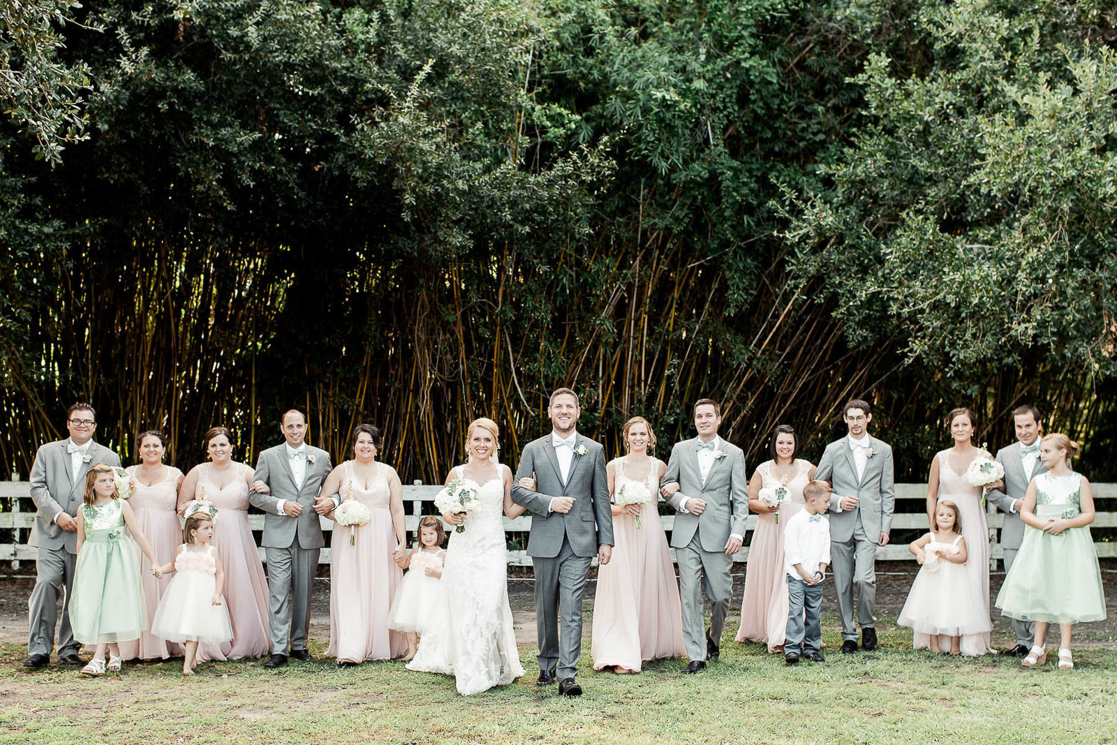 Wedding party lines up next to a picket fence, Alhambra Hall Charleston Wedding Photography.