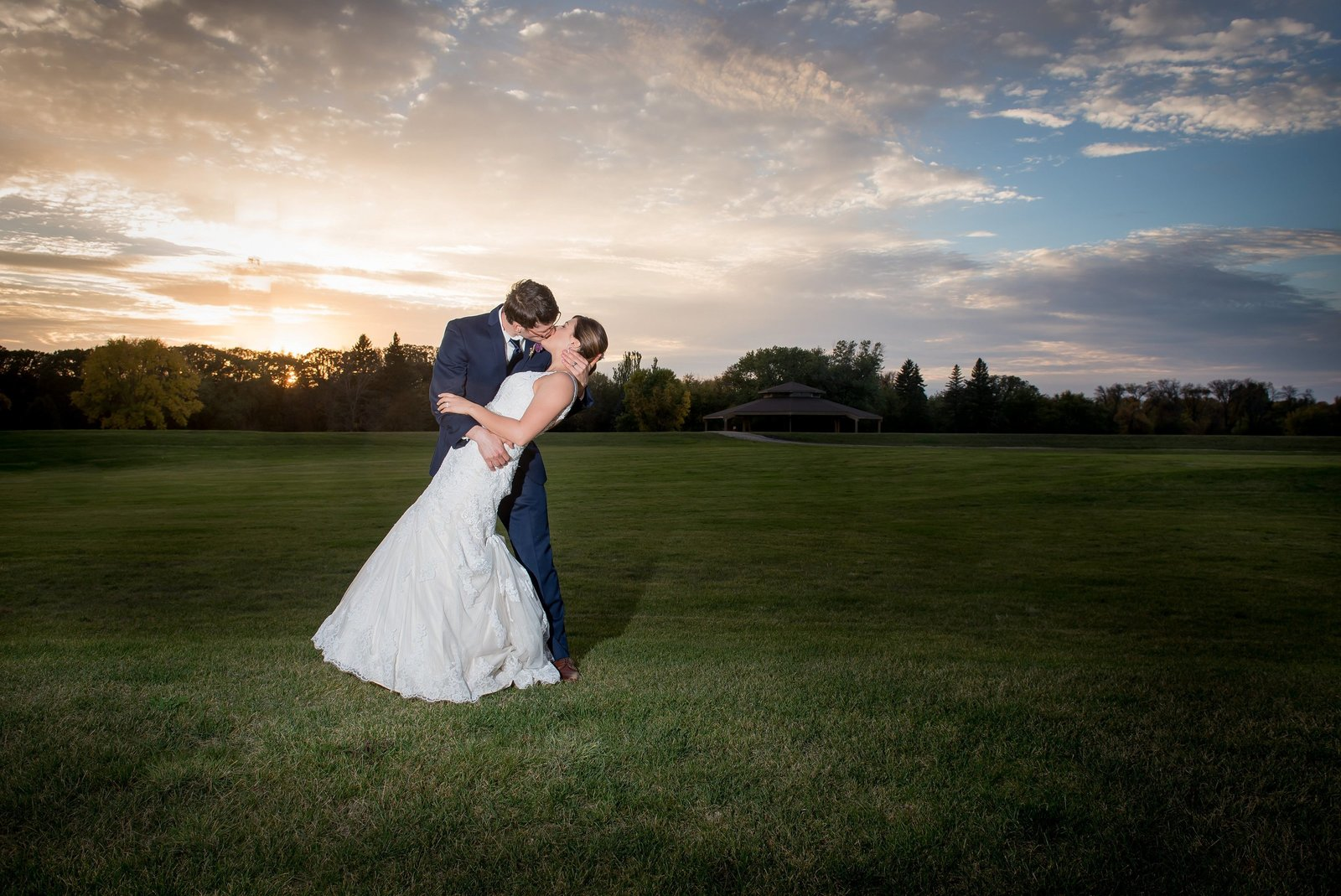Off Camera Flash photography captured this sunset wedding photos by Kris Kandel in Fargo