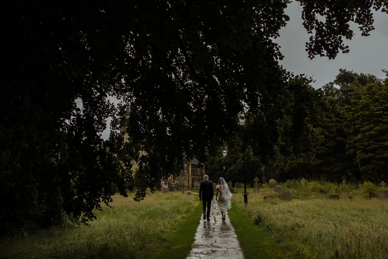 Bride with father at Adel Church, Leeds. Yorkshire documentary photographer