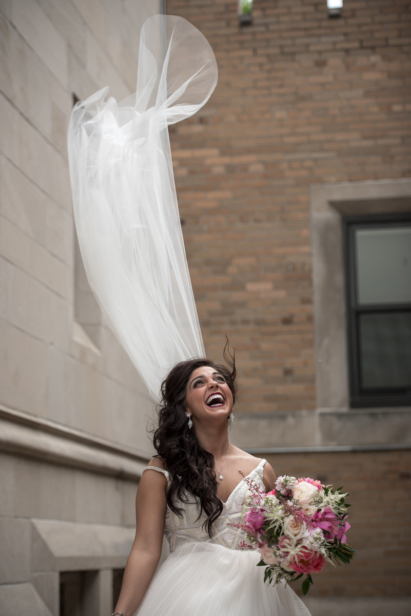 bride laughing blowing veil grand island nebraska