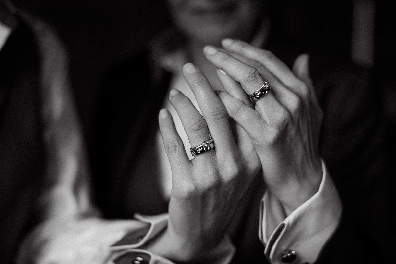 black and white gay wedding  photo captured by Adorlee Photography - Two beautifully feminine hands show these stunning engagement rings and wedding bands at this same sex wedding in Chichester, West Sussex