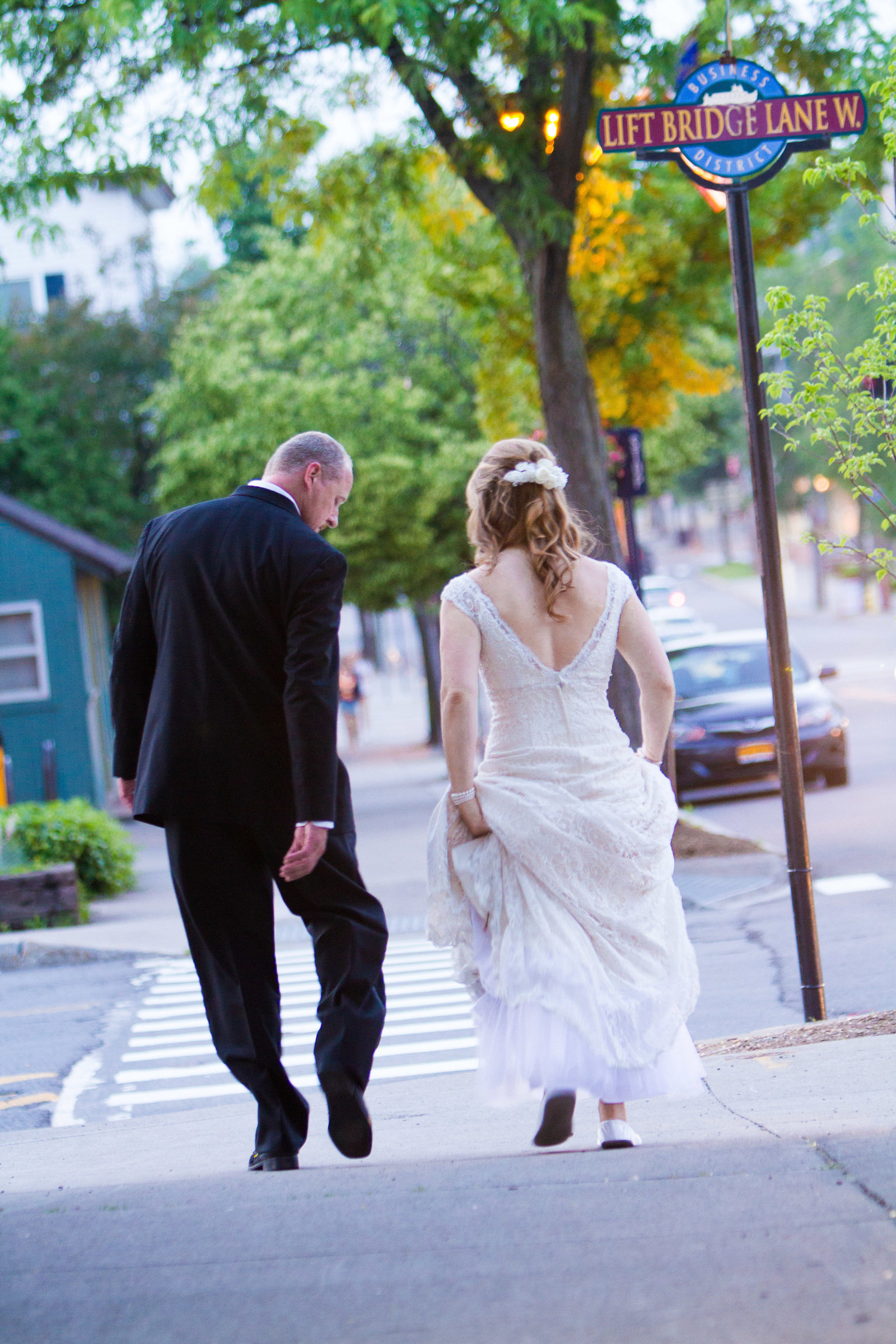 wedding photography bride and groom walking on street