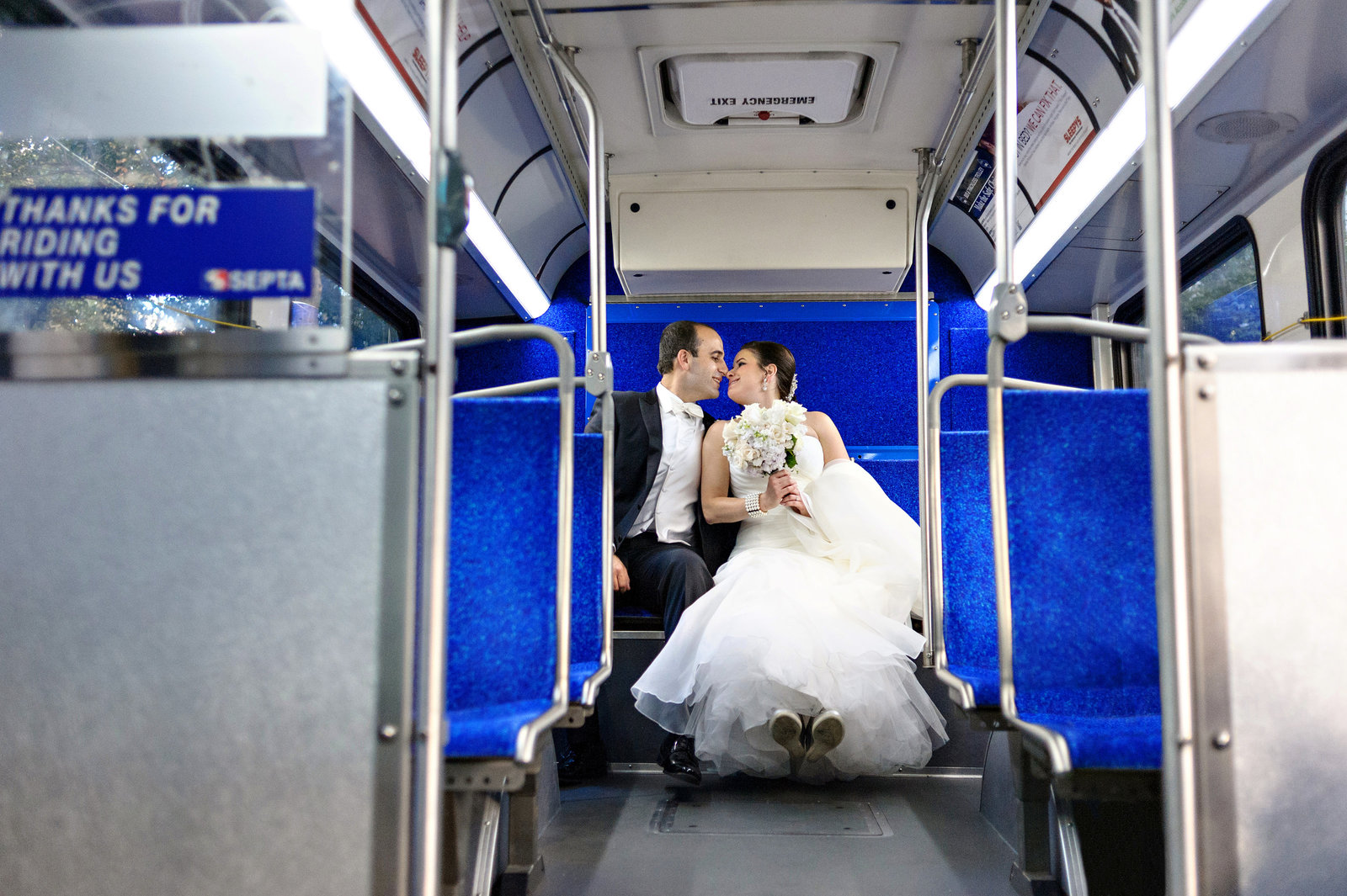 A jewish couple ride the septa bus to their American Jewish History Museum Wedding.