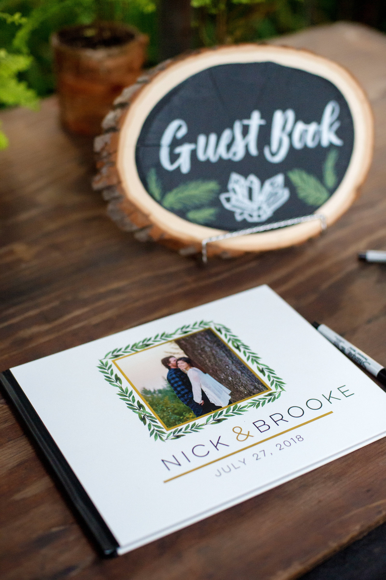guest gook sign written on cut wood