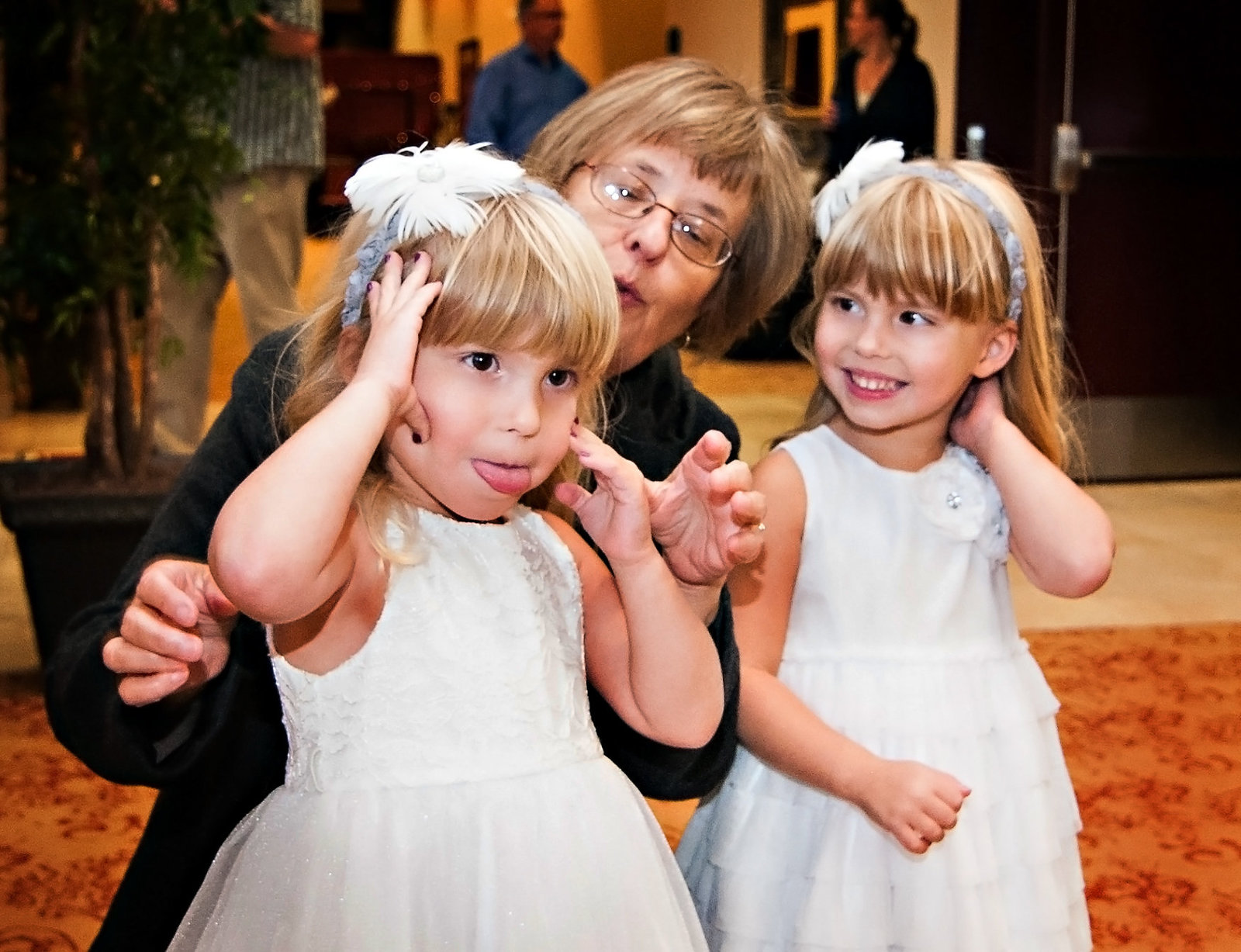 Grandma isn't sure what to do with the flower girls at a Mt. Zion reception