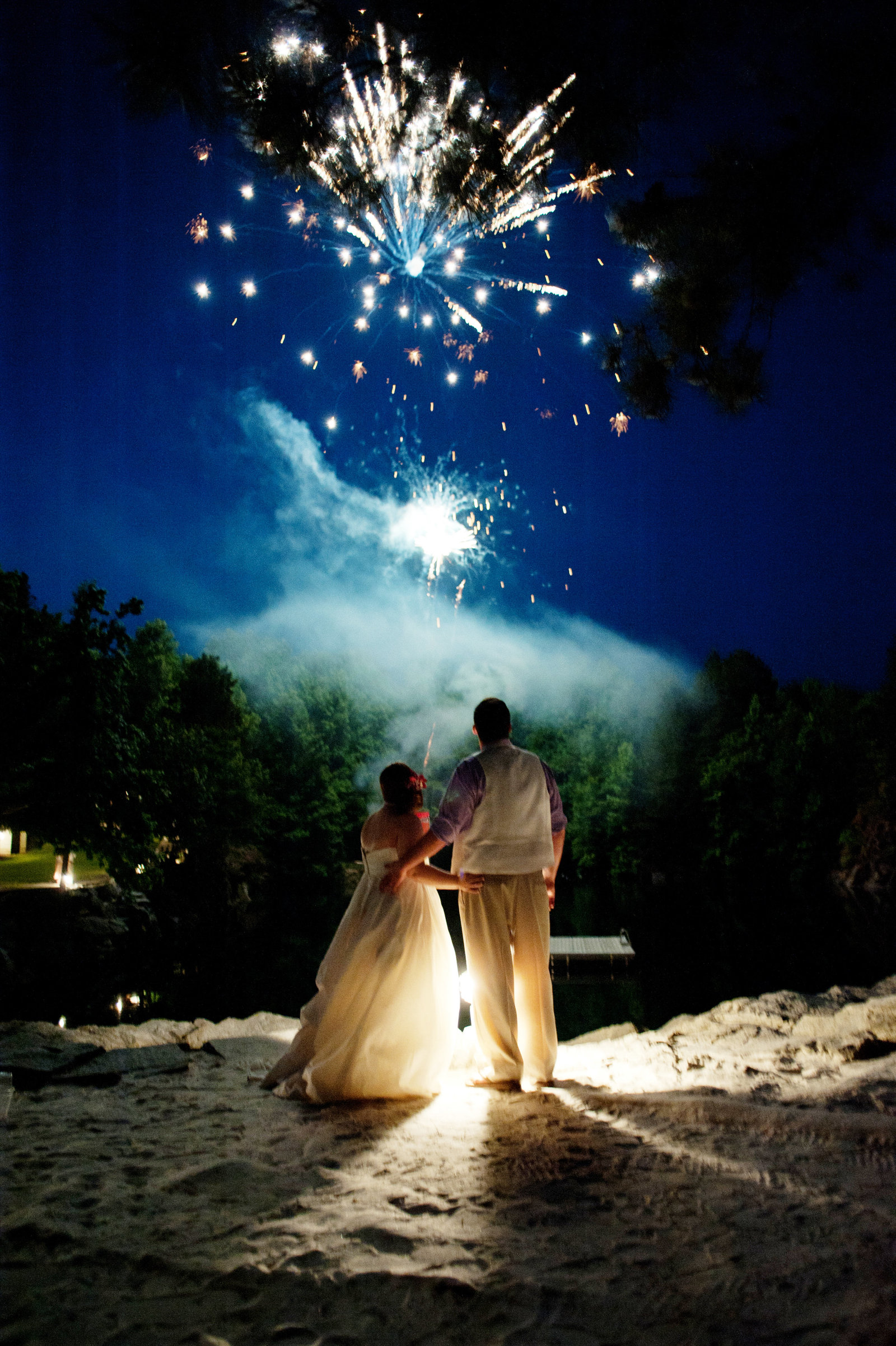 fireworks explode over wedding couple at carrigan farms