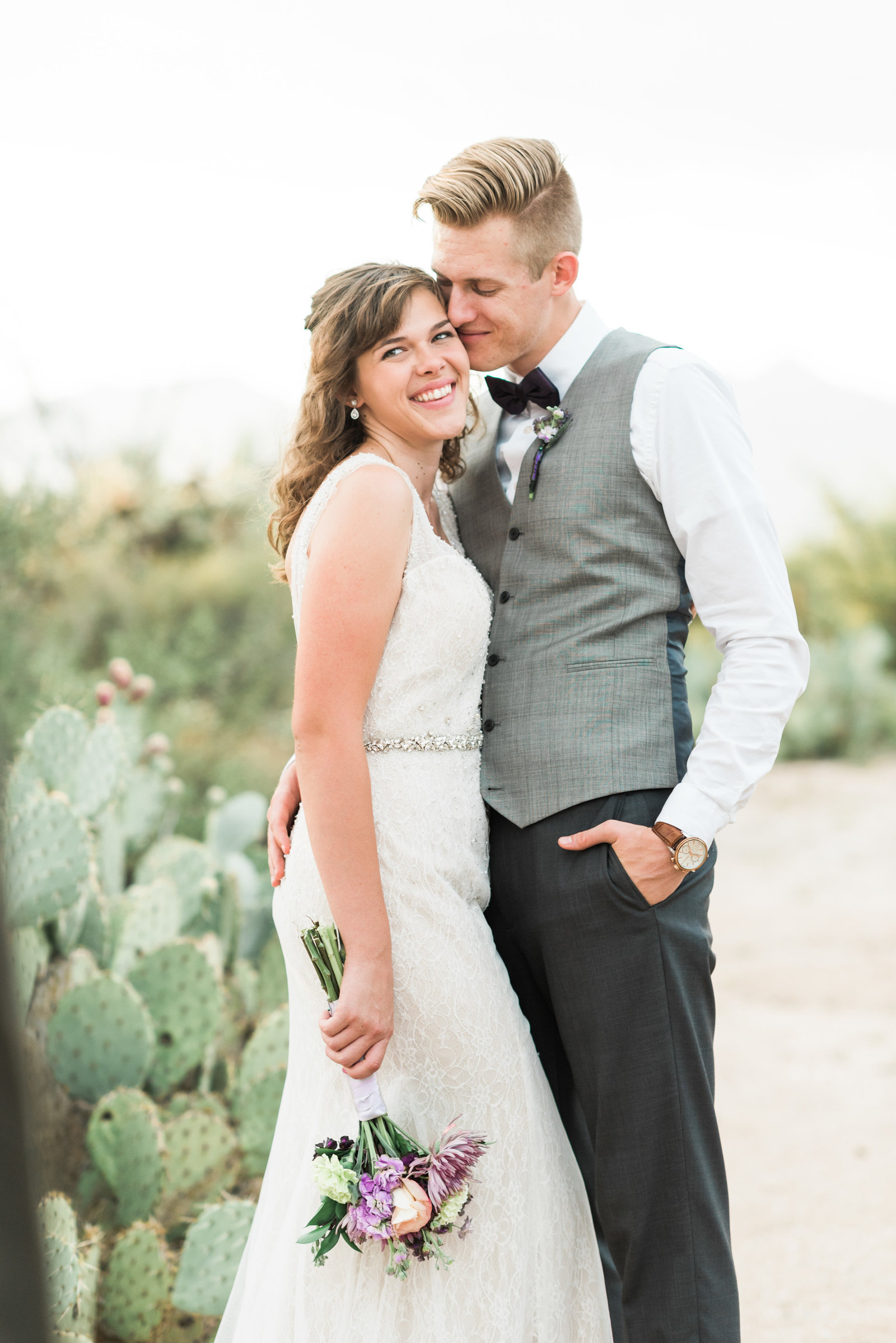 Case Park Desert Wedding Photo of Bride and Groom Snuggling