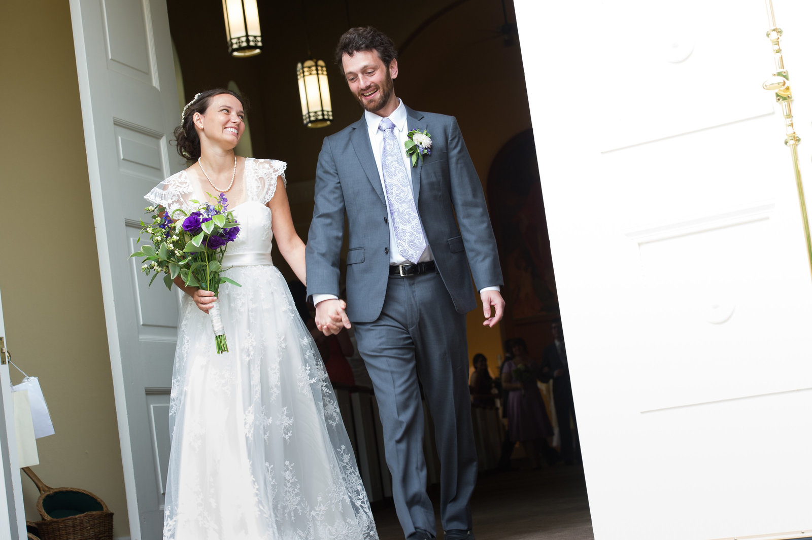Bride and groom leave church smiling after ceremony, Charlottesville, VA.