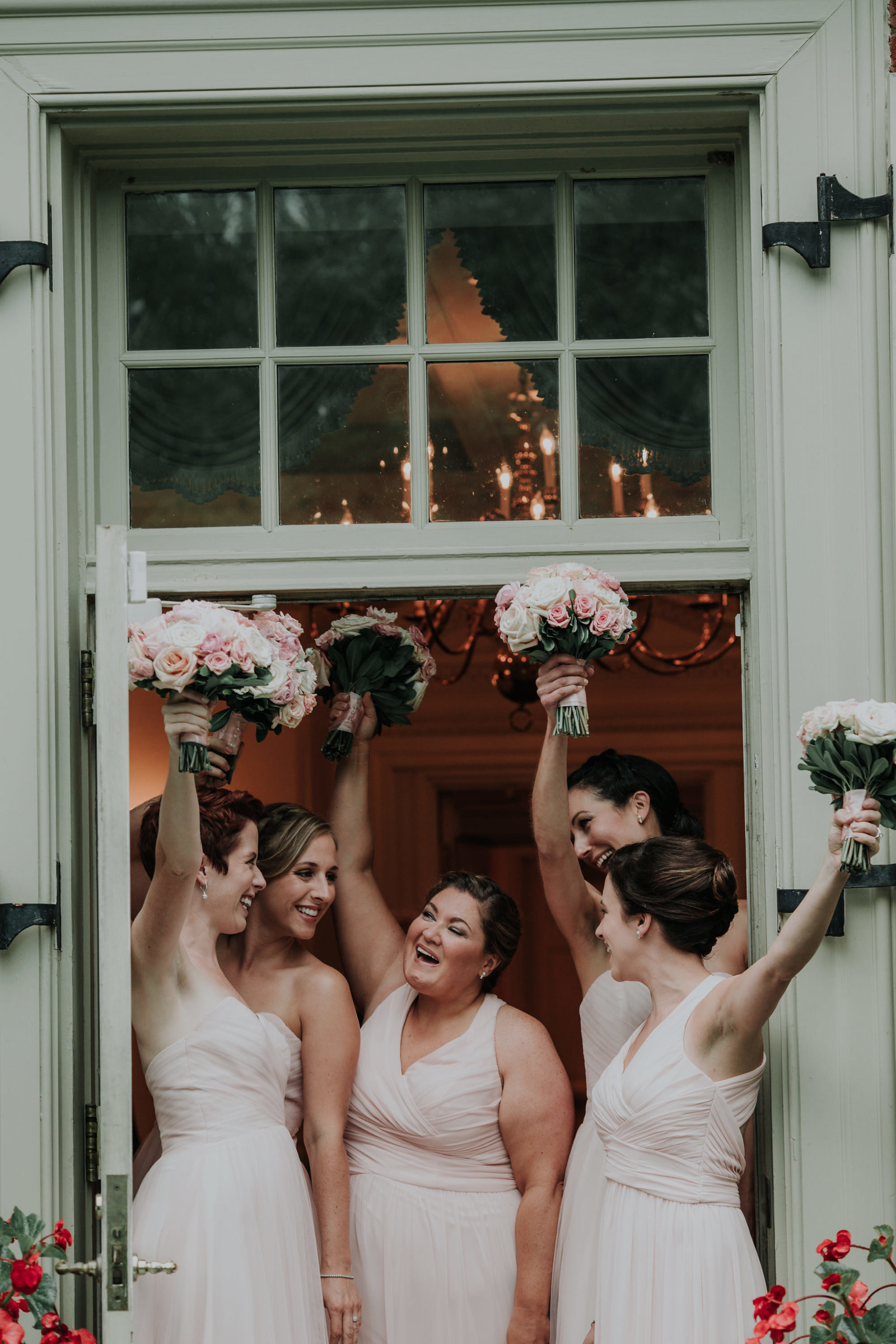 bridesmaids cheer at the brantwyn estate in wilmington delaware
