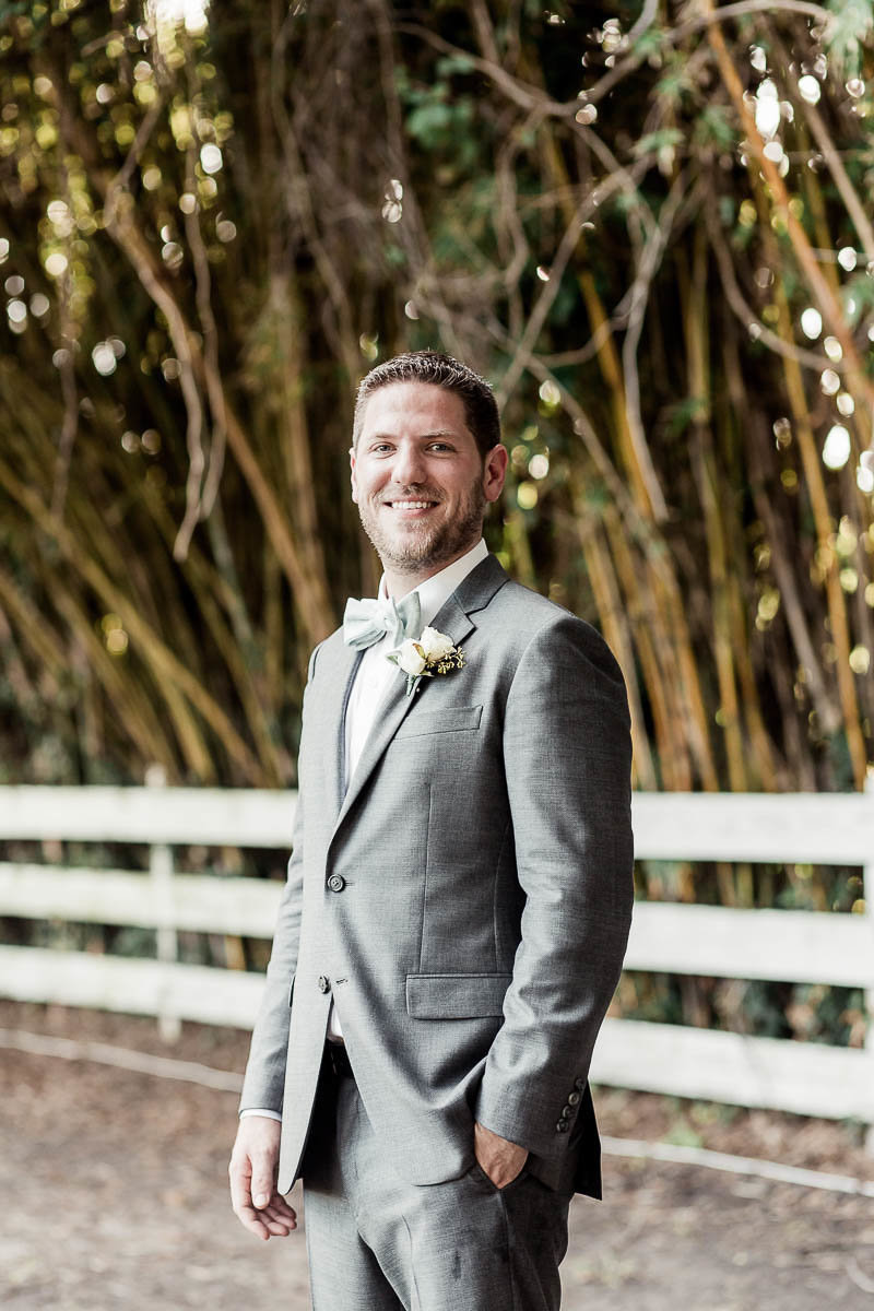 Groom stands by bamboo, Alhambra Hall, Mt Pleasant, South Carolina