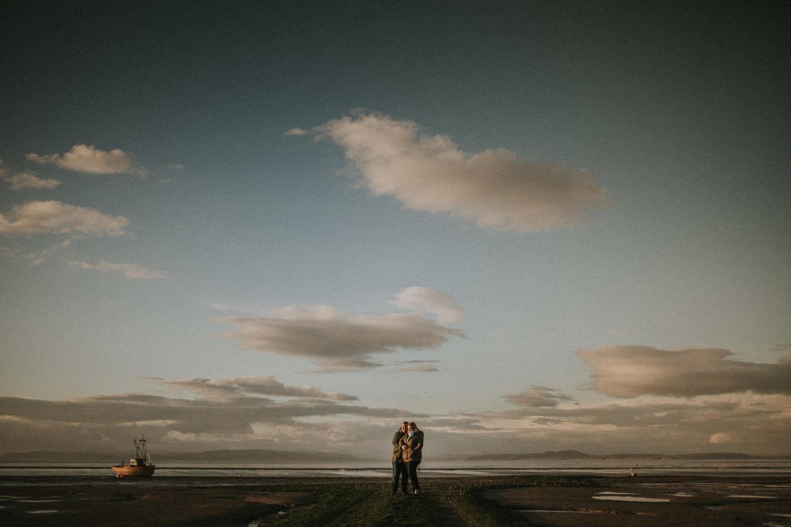 Cumbria Wedding Photographer Jono Symonds captures newly engaged couple with a backdrop of Morecambe Bay