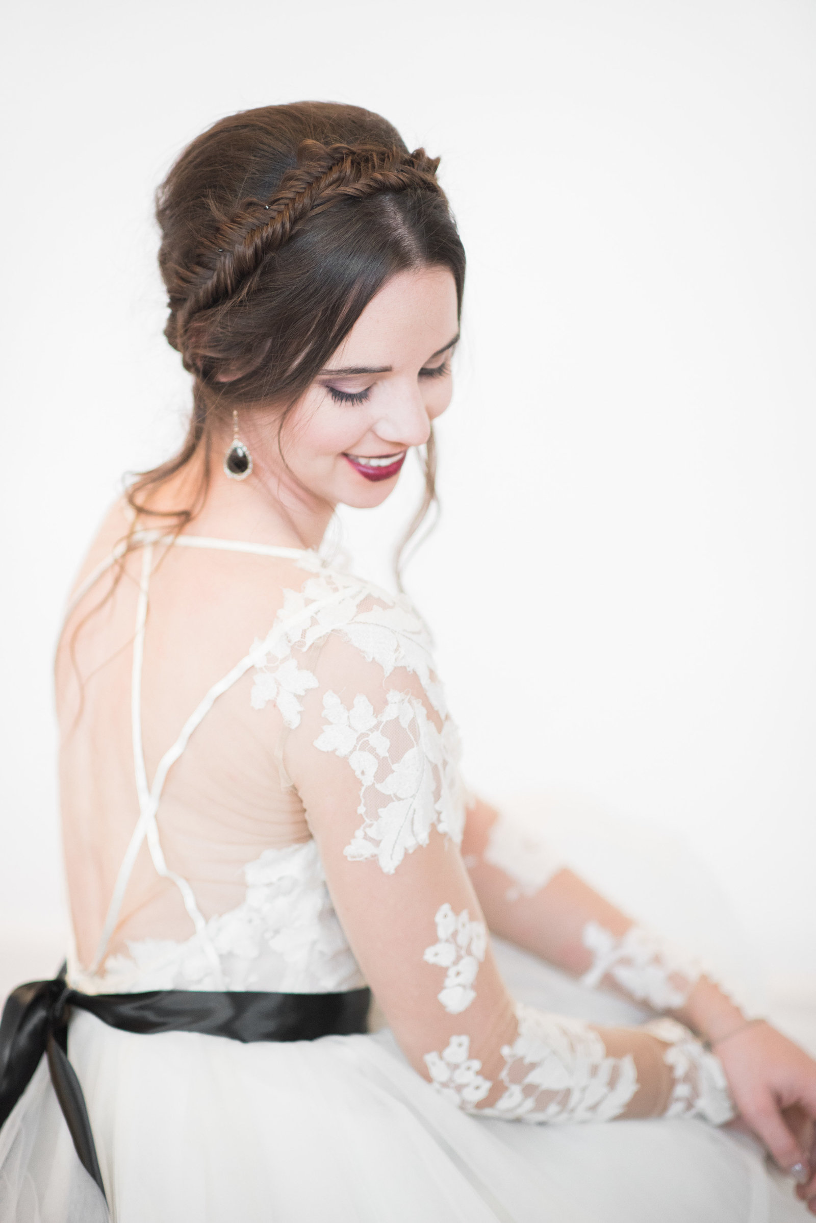 Bridal portrait of bride wearing a white lace wedding dress
