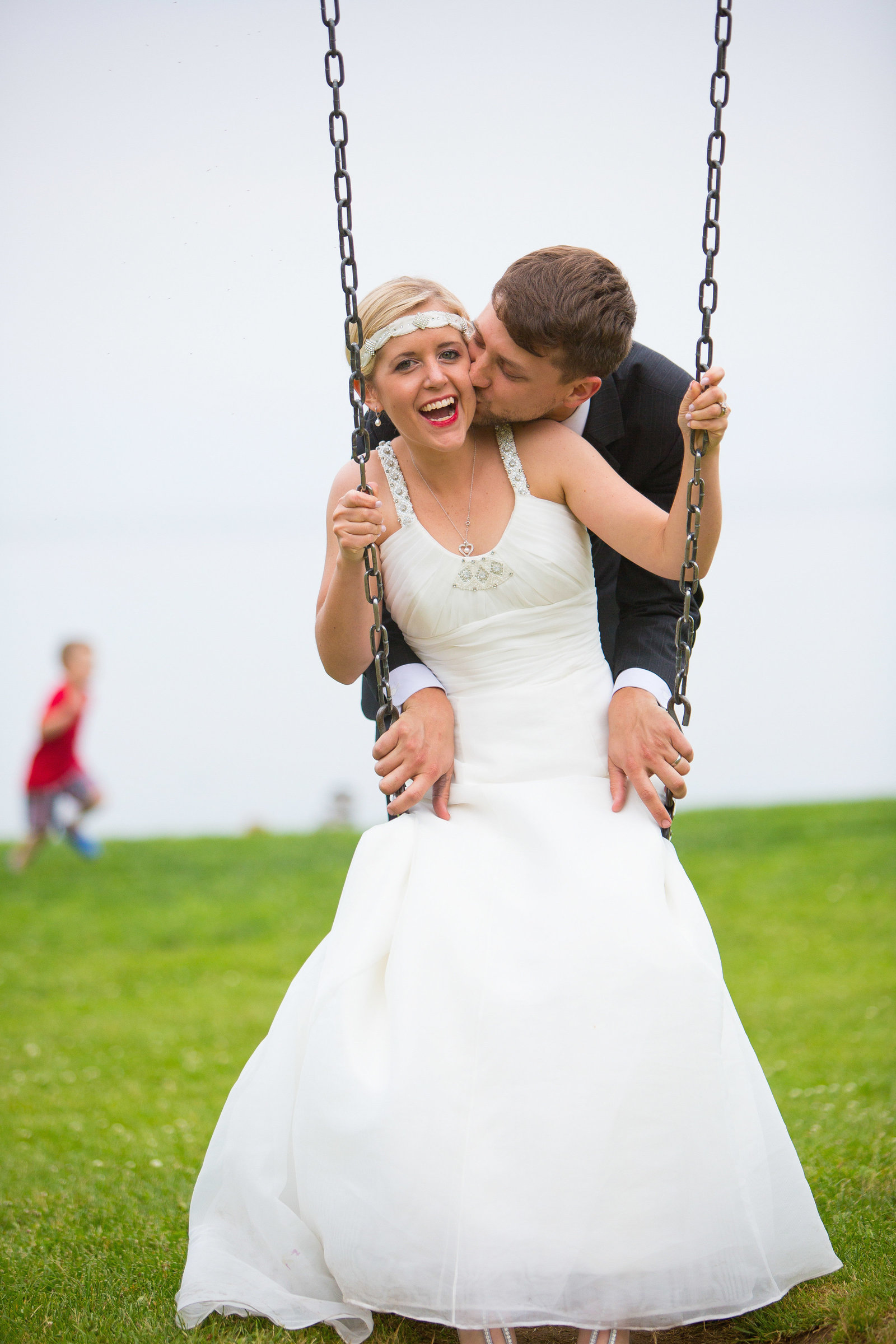 wedding photography bride and groom on swing