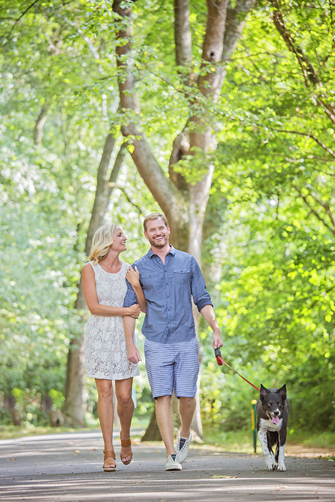 Charlotte wedding photographer Jamie Lucido, fun engagement session at a park during spring, with happy couple and dog