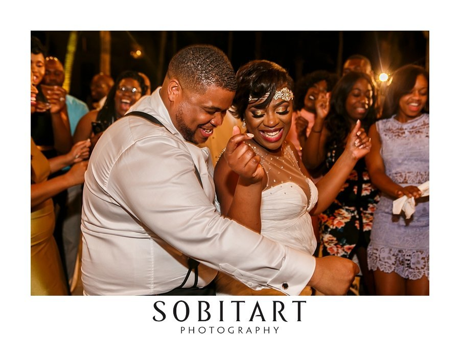 Jamaican and Haitian wedding reception  music by DJ Ricky Bonds for destination wedding reception at Dreams Resort Los Cabos, Mexico