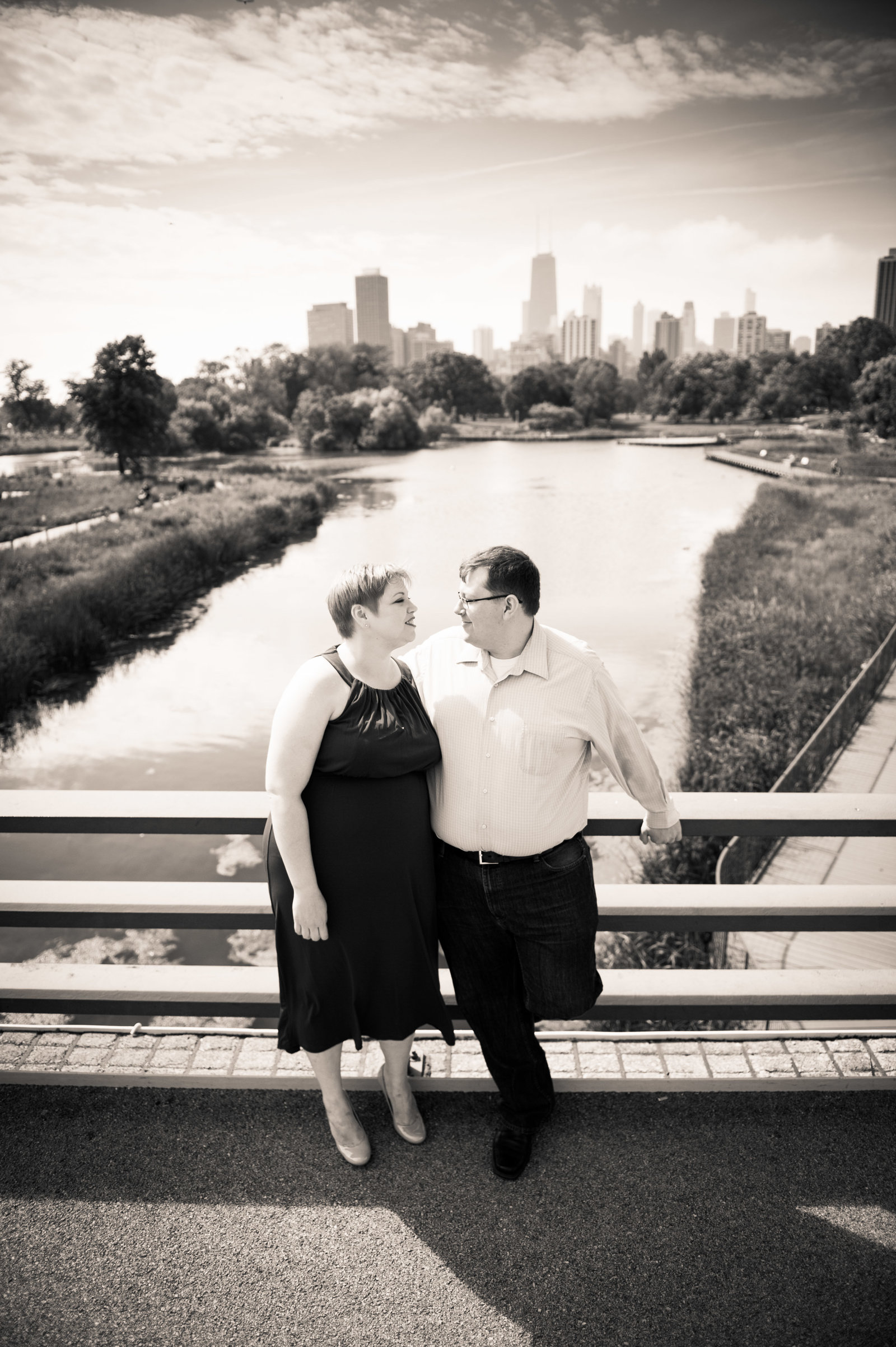 Engagemed couple pose with Skyline at Lincoln Park Zoo.