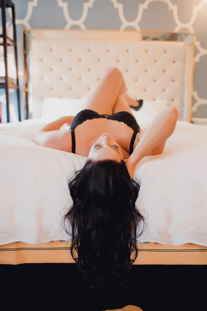 Ms S lays in bed with black lingerie, Boudoir Photography, Charleston, SC